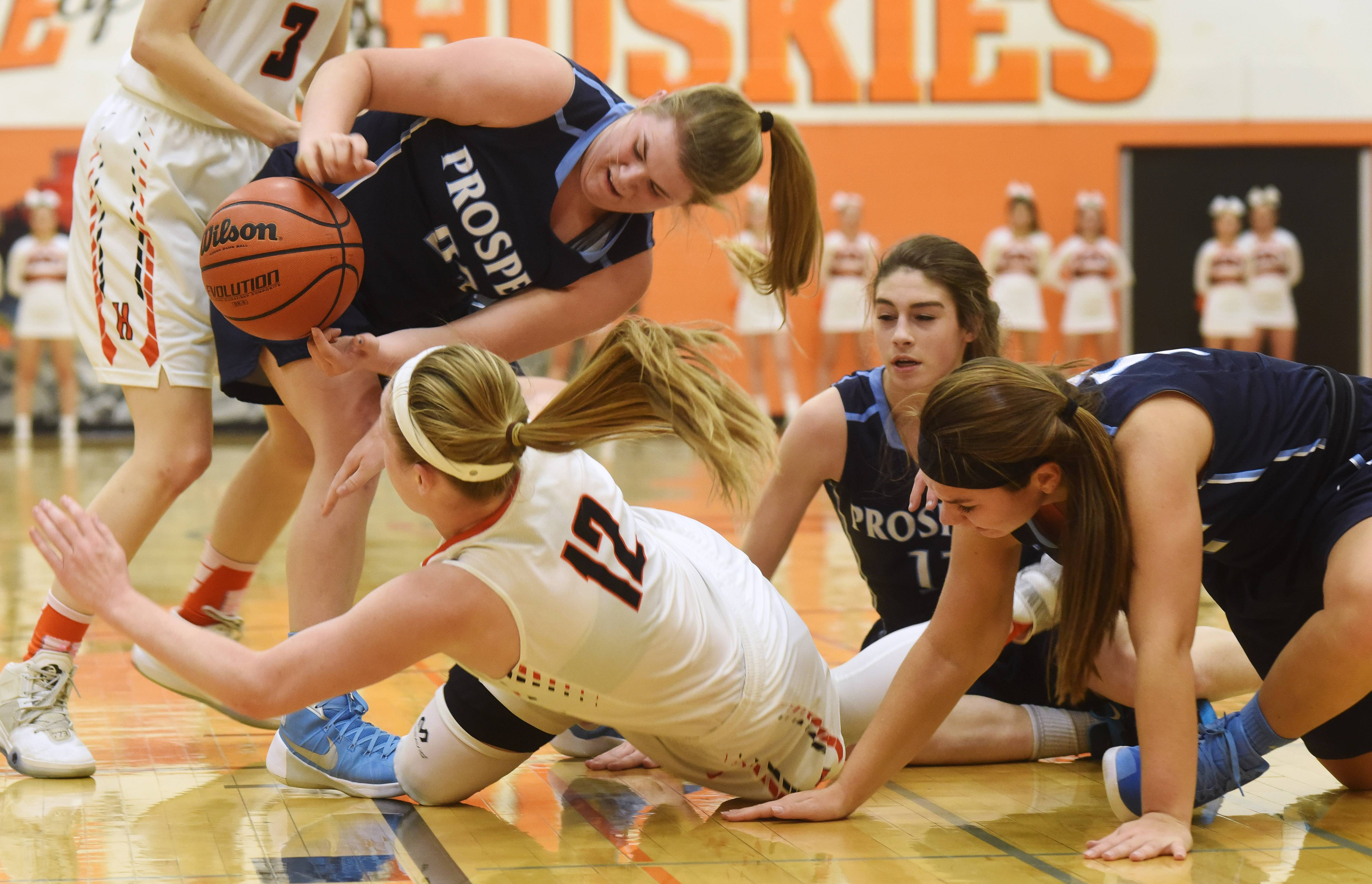 Prospect players, from left, Kendra Gancarz, Mandy Whithey and Margherite Pettenuzzo, as well as Hersey's Claire Gritt, try to gain control of a loose ball during Friday's game in Arlington Heights.