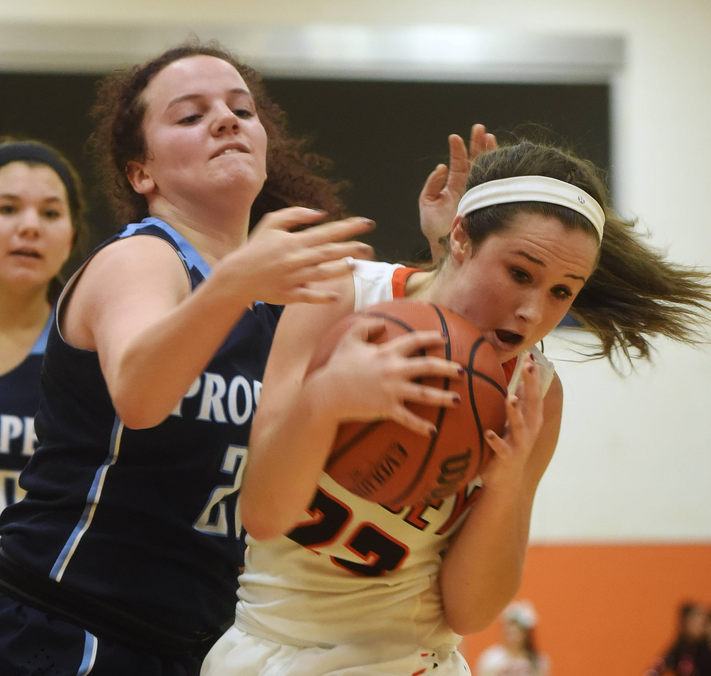 Hersey's Carly Silva takes possession of the ball in front of Prospect's Mary McKenna during Friday's game in Arlington Heights.