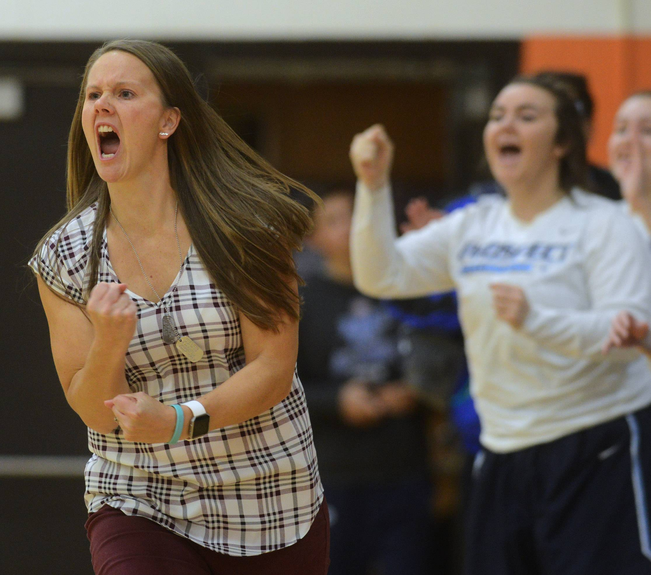 Prospect girls basketball coach Gabrielle Lovin cheers for her team during Friday's game against Hersey.