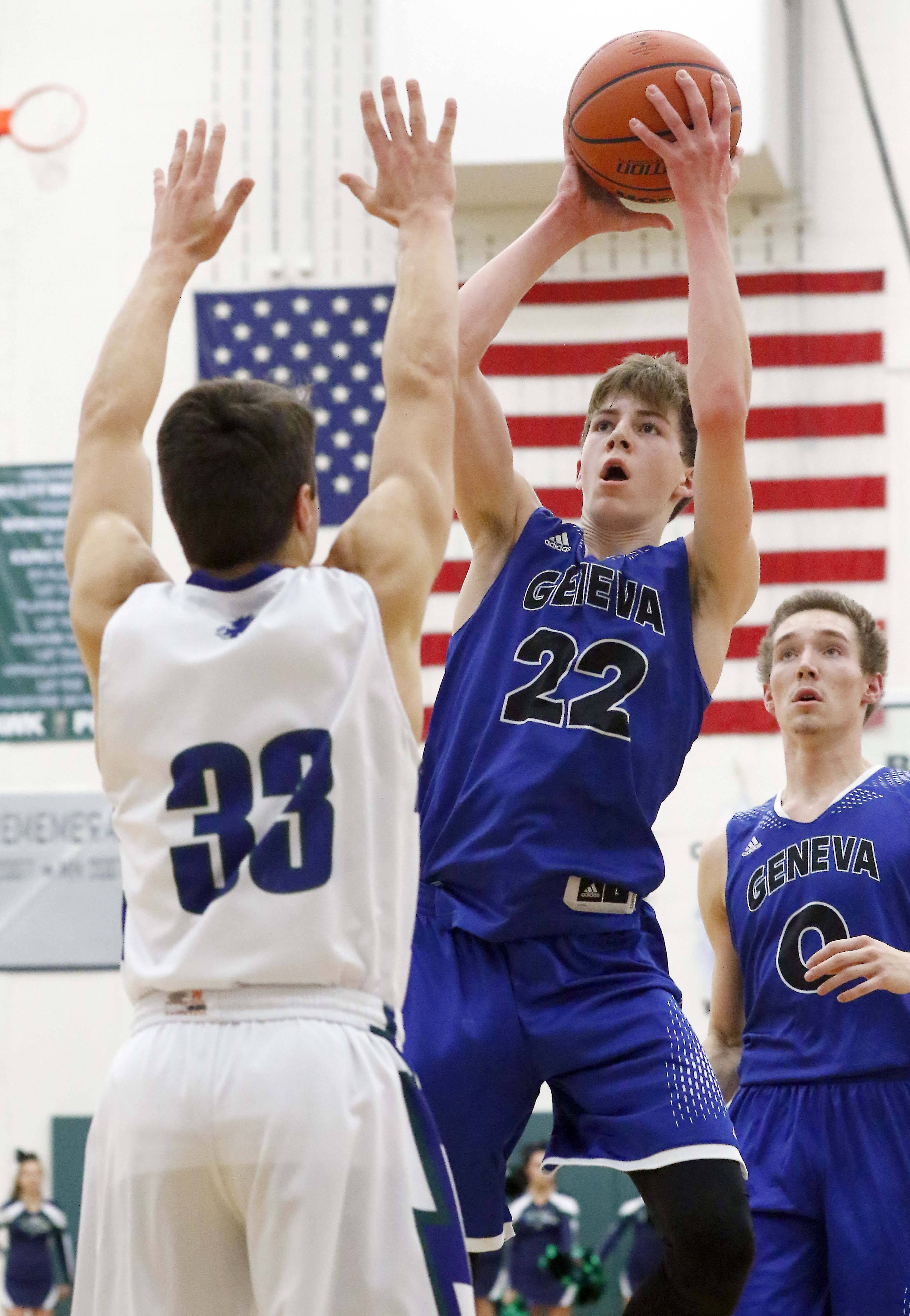 Geneva's Mitch Mascari goes to the hoop over Bartlett's Drew Martin Friday.