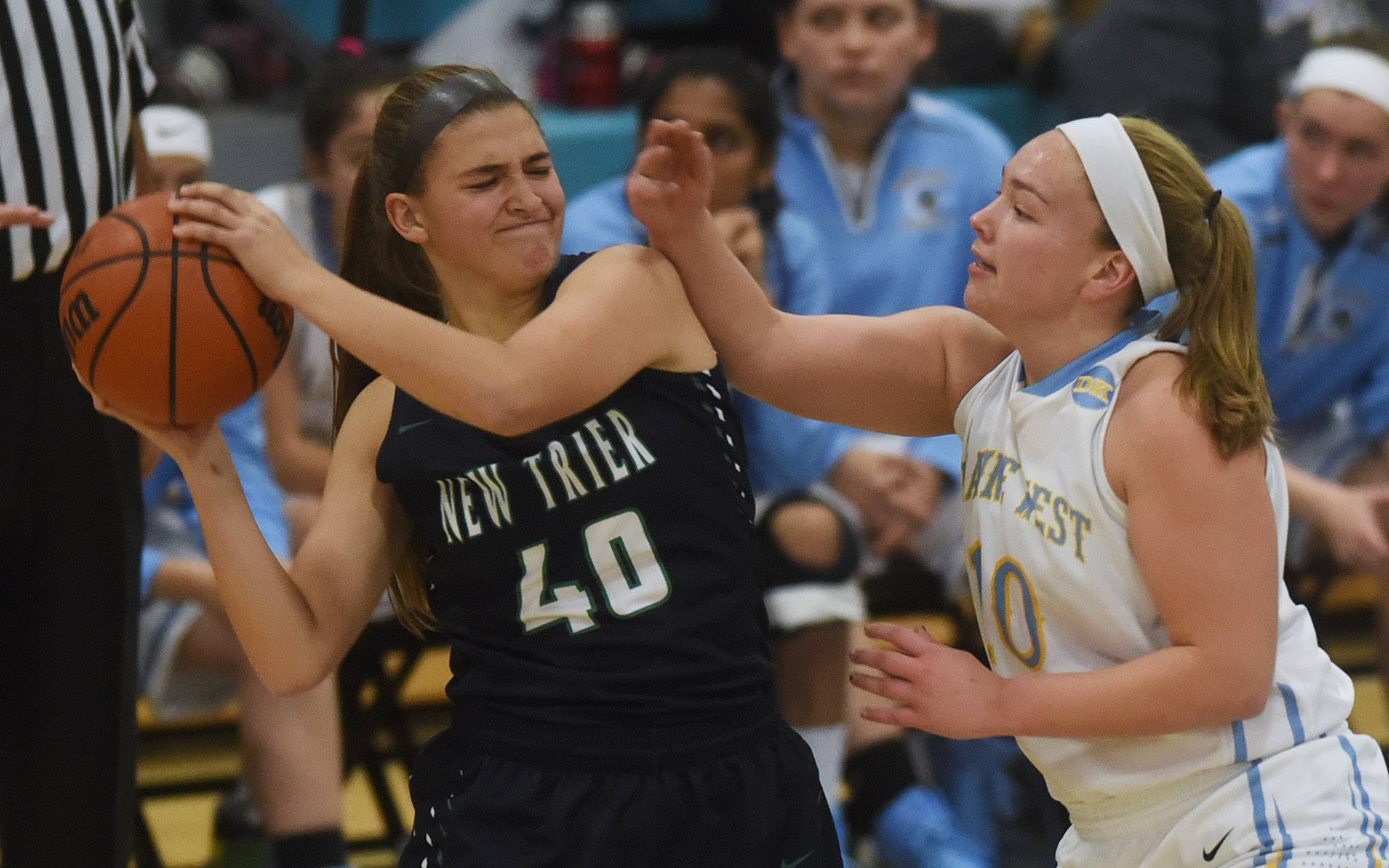 New Trier's Nicole Kaspi, left, is closely guarded by Maine West's Allison Pearson during Tuesday's game in Des Plaines.