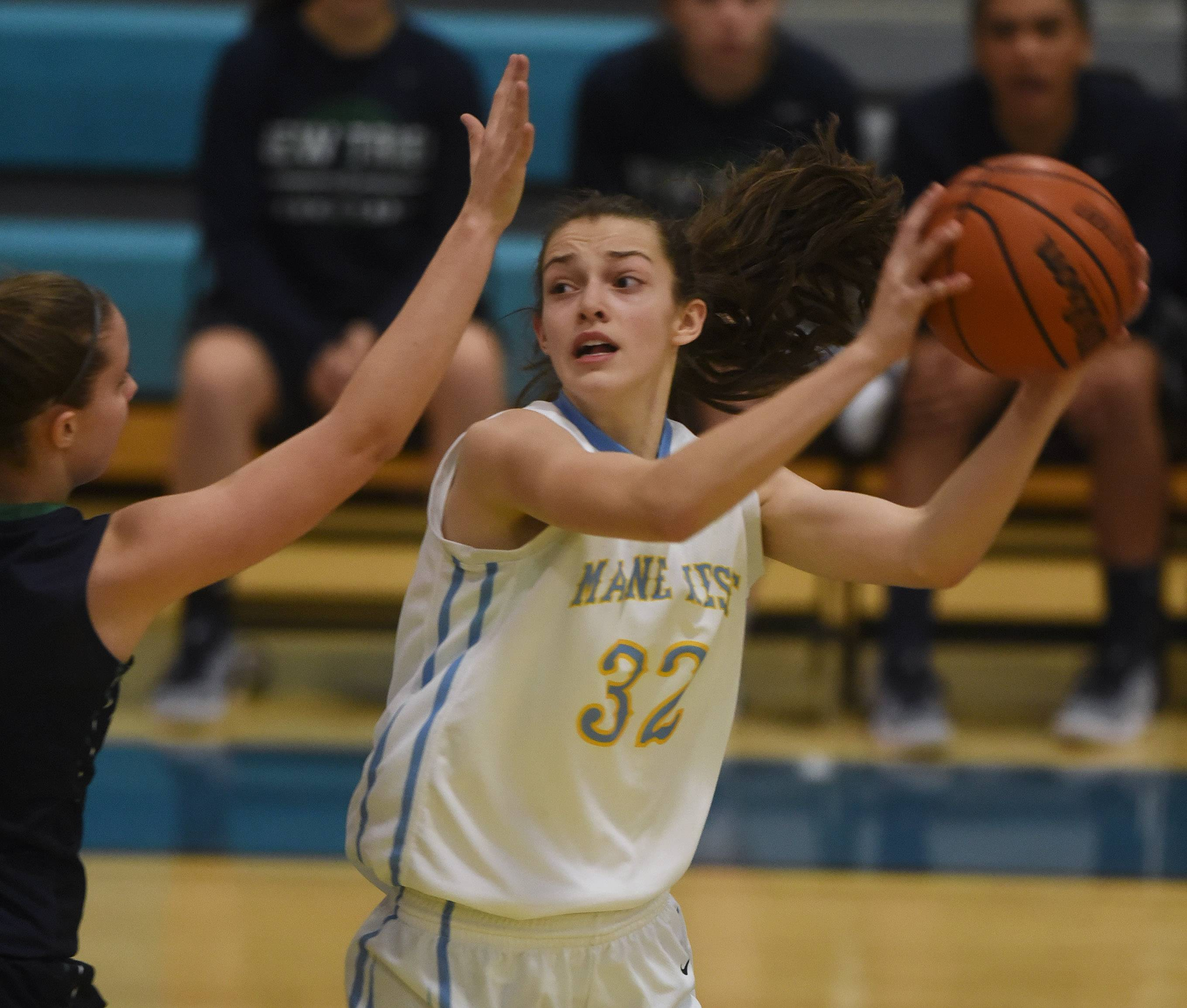 Maine West's Angela Dugalic looks for an open teammate during Tuesday's game against New Trier in Des Plaines.