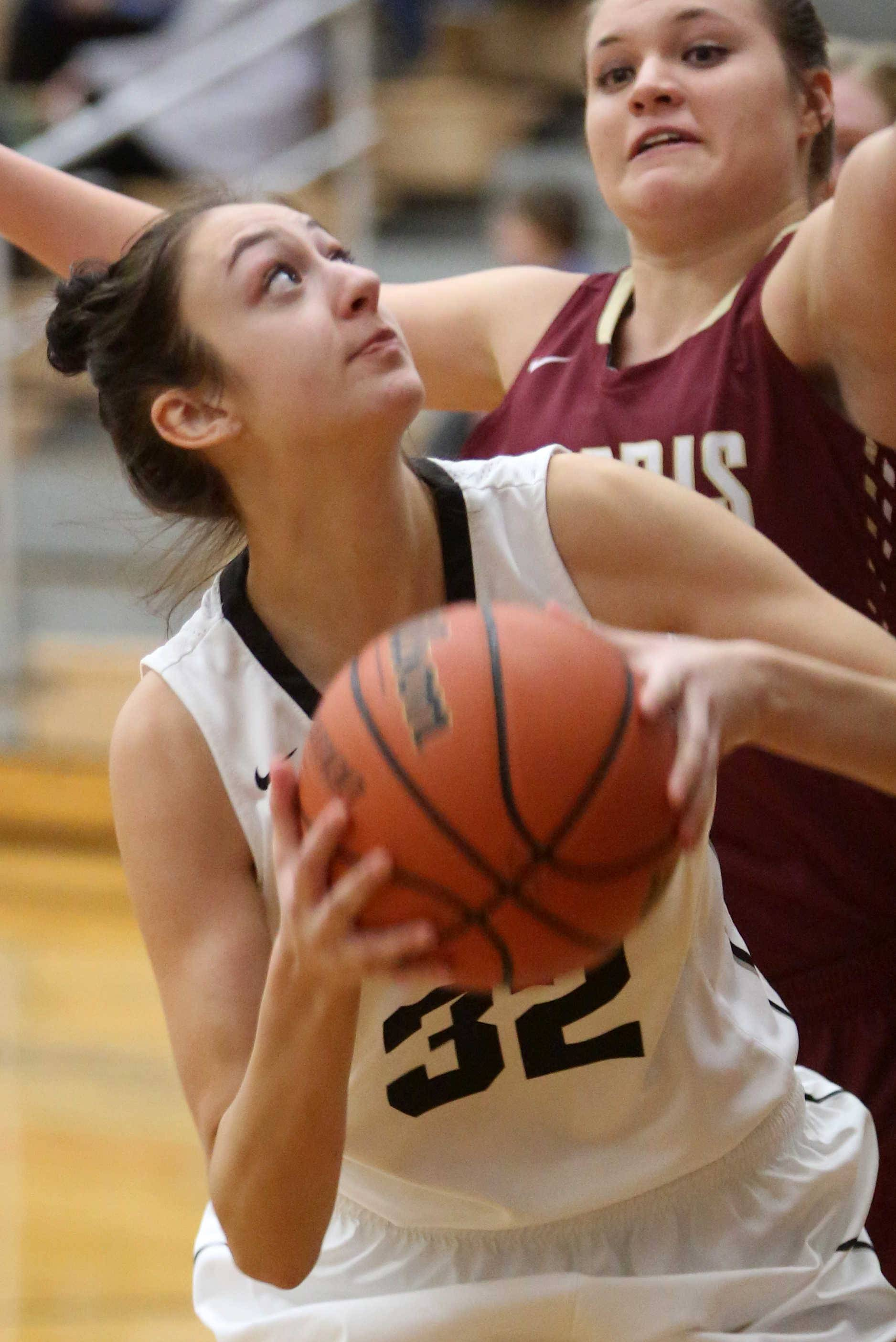 Kaneland's Addie Ringel looks to the hoop against Morris during varsity basketball action at Kaneland Tuesday night.