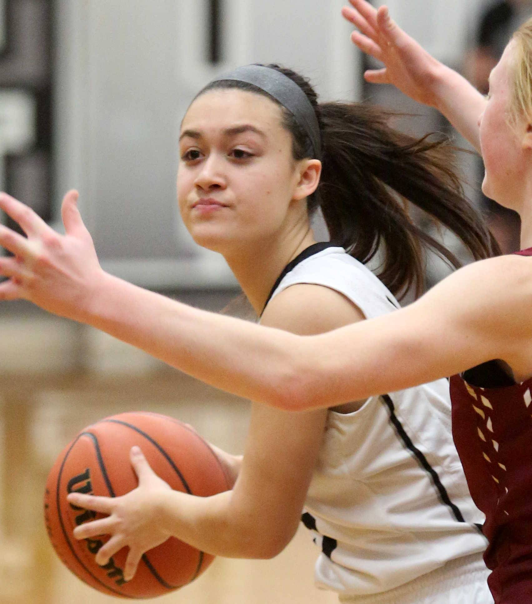 Kaneland's Hannah Armin looks for an option against Morris during varsity basketball action at Kaneland Tuesday night.