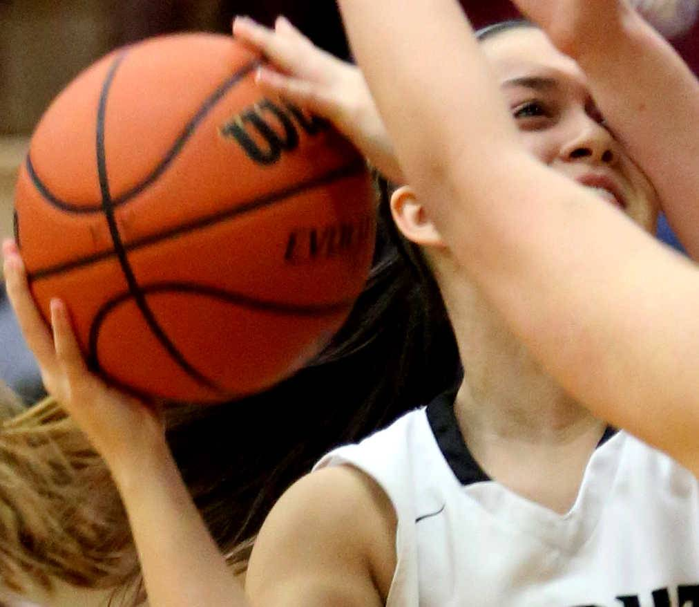 Kaneland's Hannah Armin encounters an arm to the face as she moves through traffic.