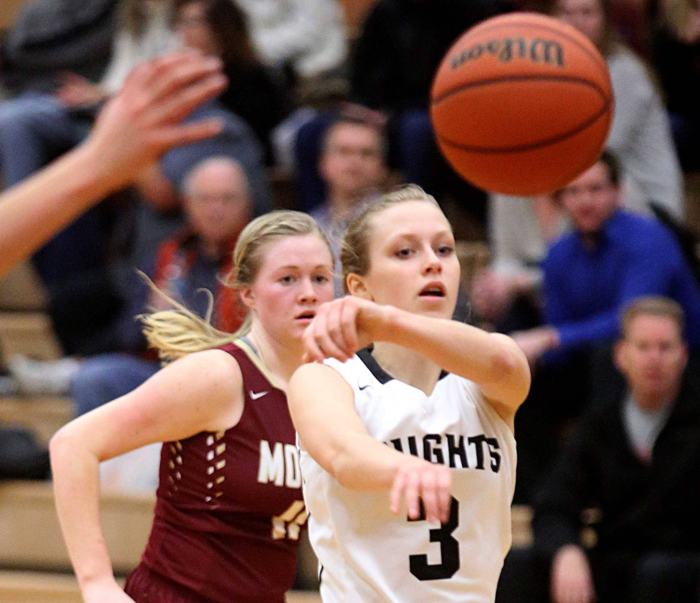 Kaneland's Jamie Martens, who made the game-winning free throws with 3.7 seconds left, passes the ball on a fast break against Morris at Kaneland Tuesday night.