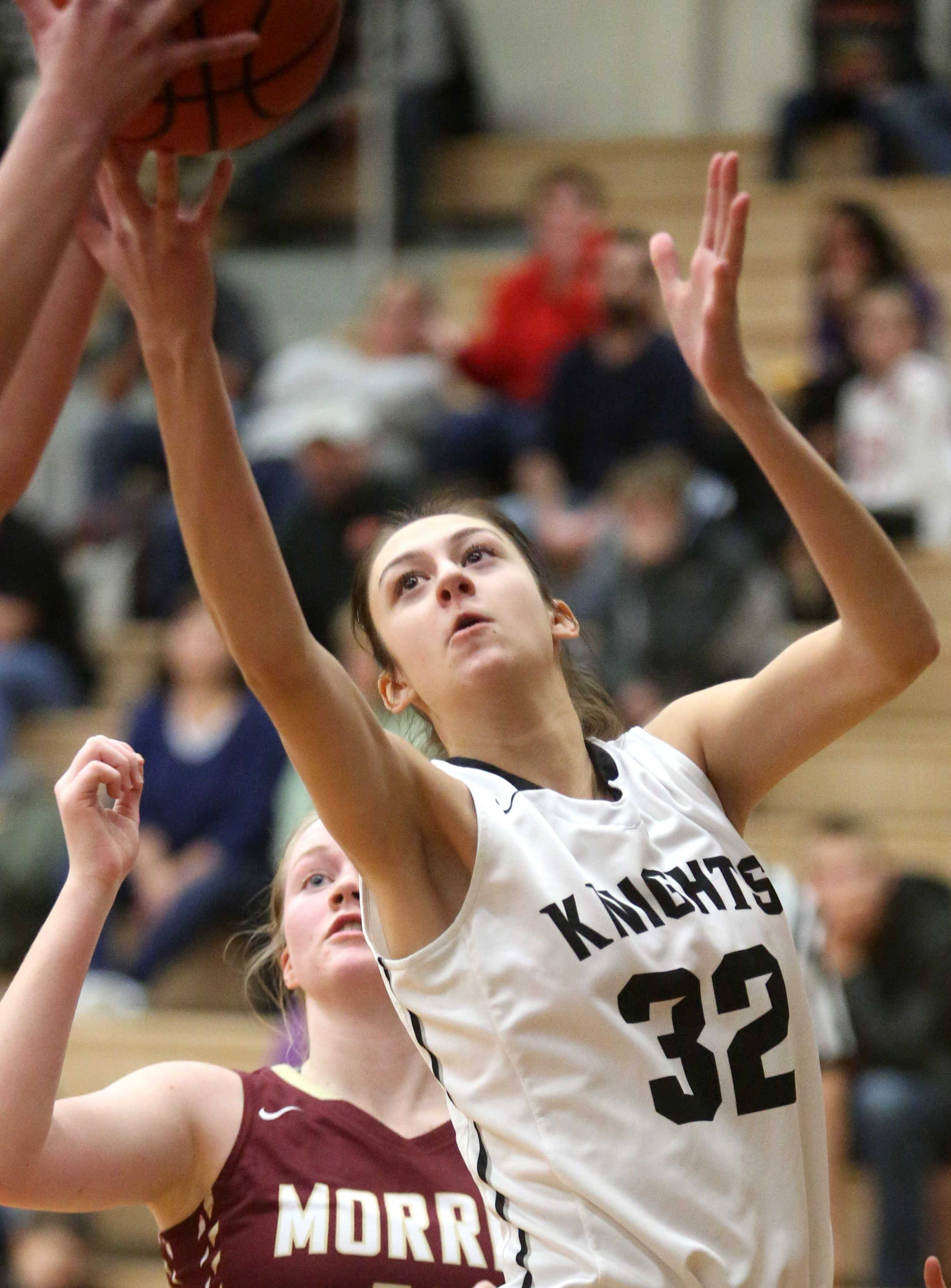 Kaneland's Addie Ringel looks for a rebound against Morris during varsity basketball action at Kaneland Tuesday night.