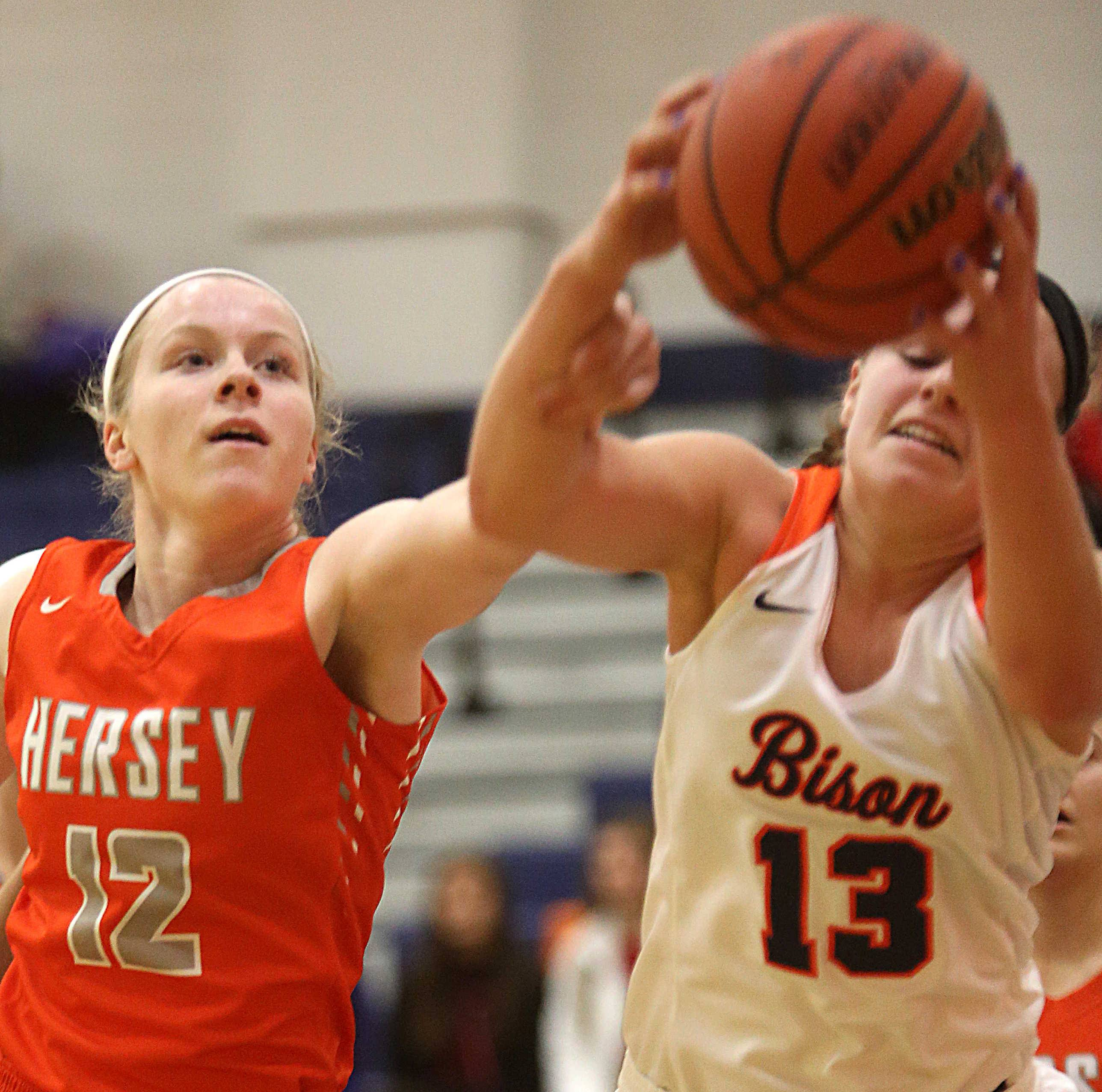 Hersey's Claire Gritt, left, and Buffalo Grove's Georgette Topalis battle for the ball during varsity basketball action at Buffalo Grove on Friday night.
