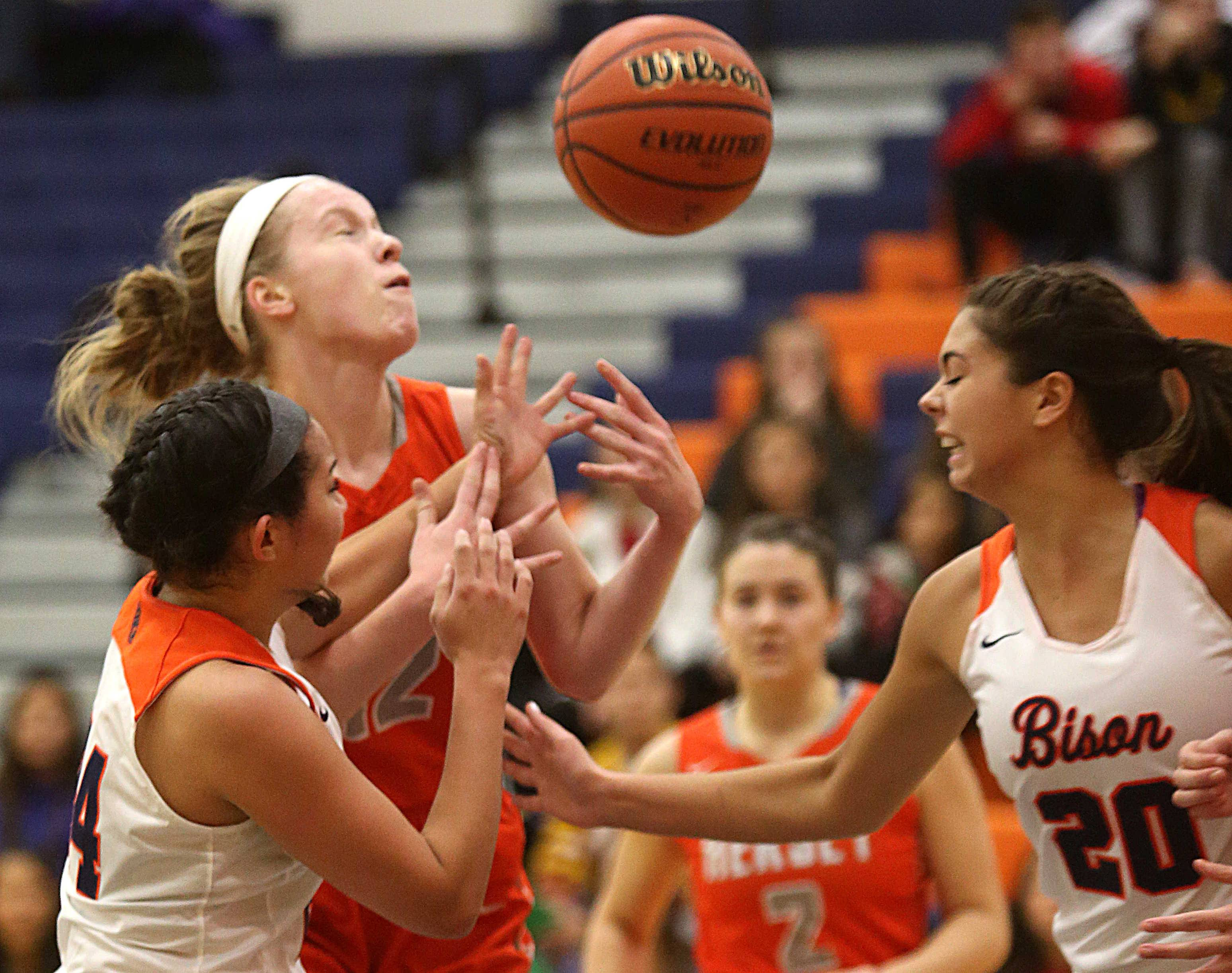 Battling for the ball are, from left, Buffalo Grove's Alyssa Floro, Hersey's Claire Gritt and Buffalo Grove's Kendall Prochaska during varsity basketball action at Buffalo Grove on Friday night.
