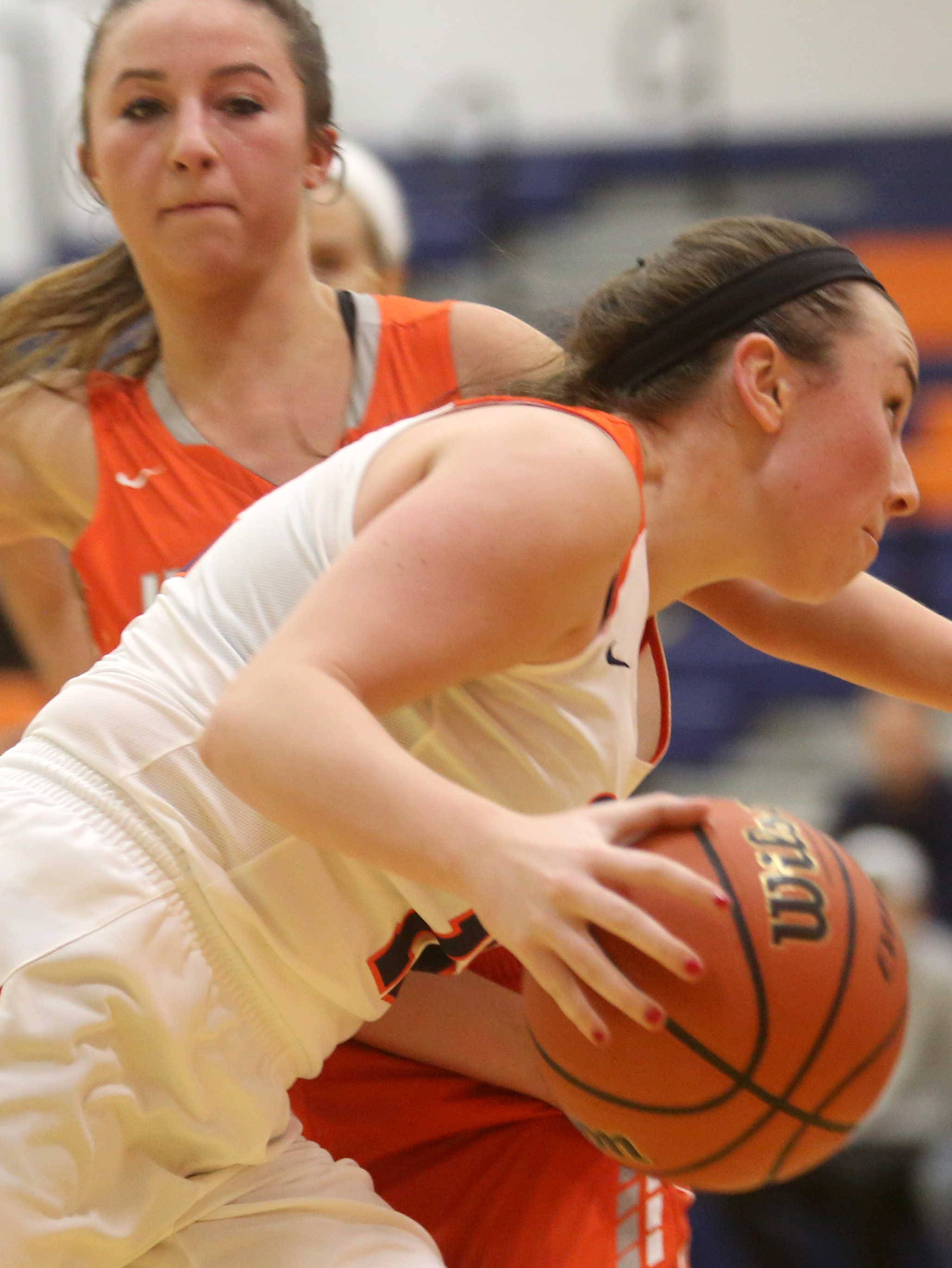 Hersey's Carley Cooper guards a driving Megan Gamber of Buffalo Grove during varsity basketball action at Buffalo Grove on Friday night.