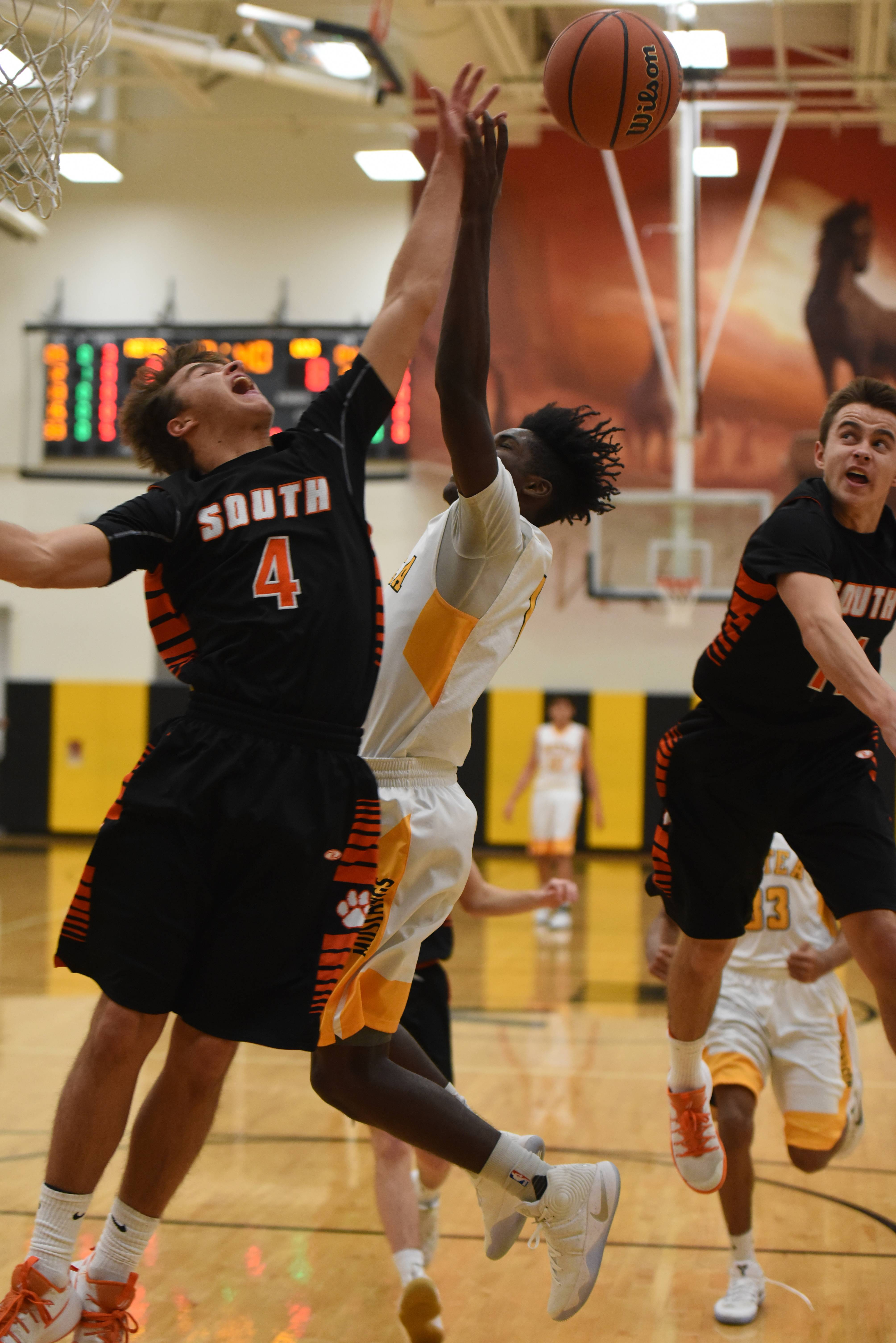 Wheaton Warrenville South's Jake Healy (04) takes a shot over Jayden Reed of Metea during the Wheaton Warrenville South at Metea Valley boys basketball game Friday.