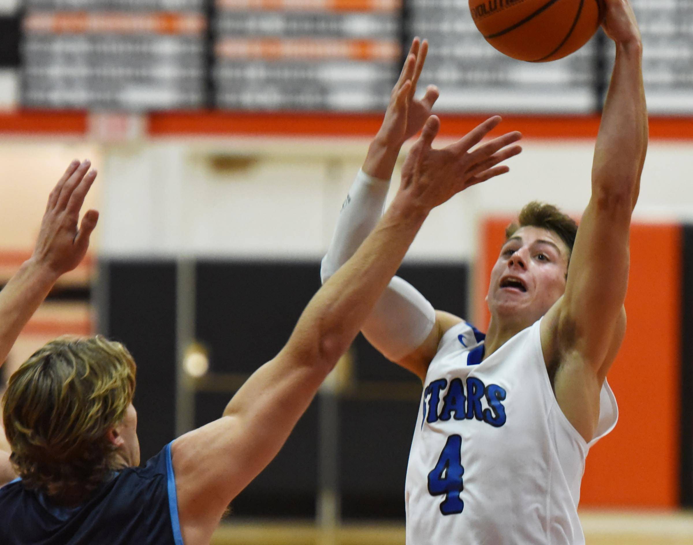 St. Charles North's Anthony Delisi shoots over Downers Grove South's Tj Clifford Friday at the 58th Ron Johnson Boys Basketball Tournament at St. Charles East earlier this season. SCN travels to the powerful Pontiac Holiday Tournament the week after Christmas.