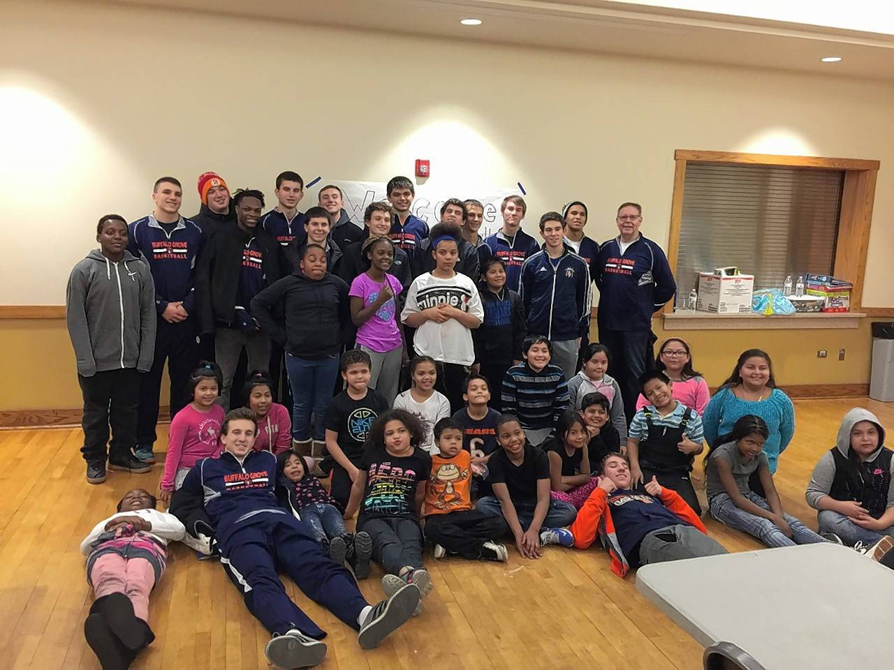 Buffalo Grove's boys basketball team recently continued a commitment with Partners for our Communities, spending a day with grade-school aged students in Palatine.