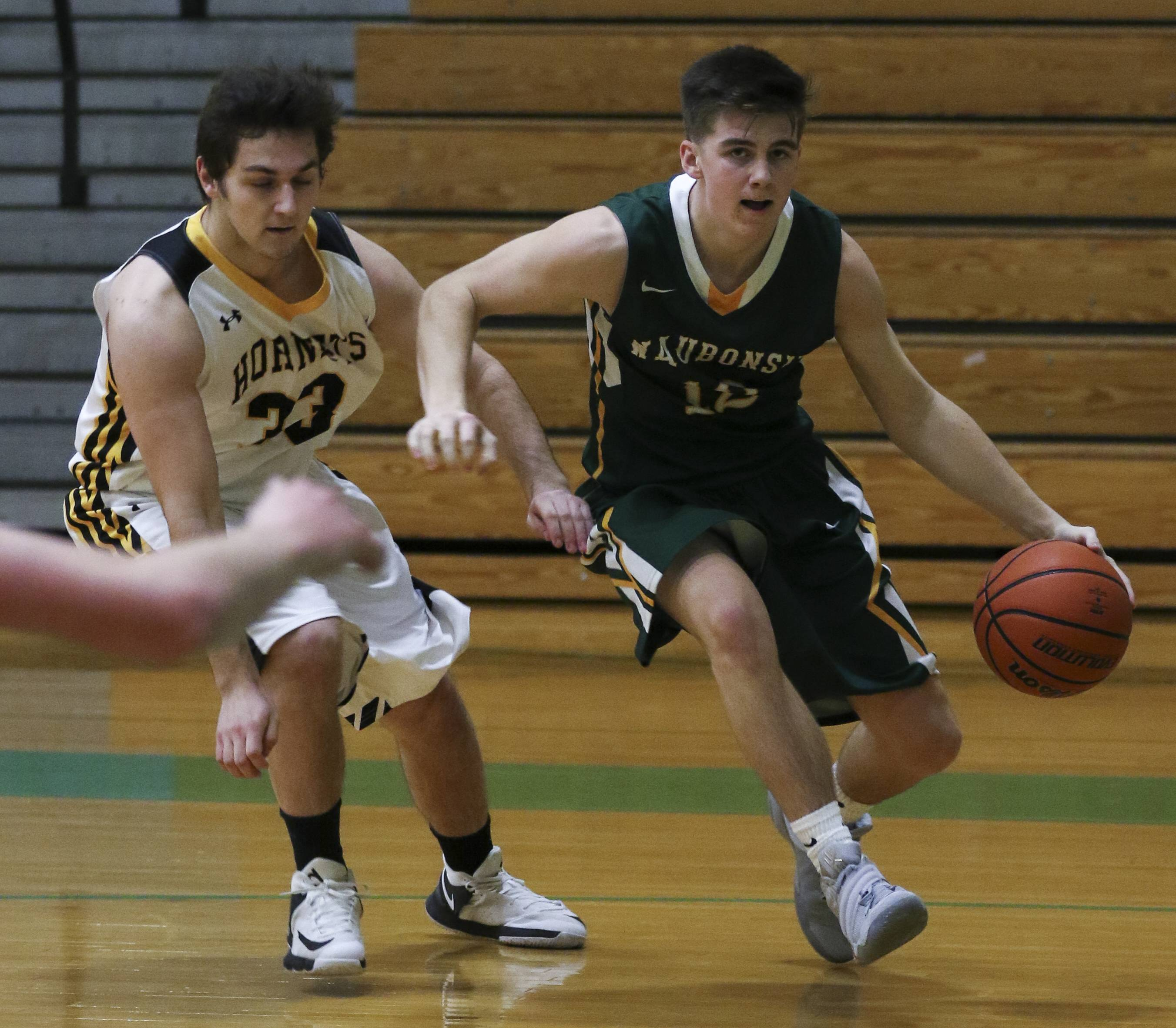 Waubonsie Valley's Justin Mullinax moves around Ethan Ashmore, left, of  Hinsdale South during boys basketball at the Jack Tosh Holiday Classic at York High School on Monday.