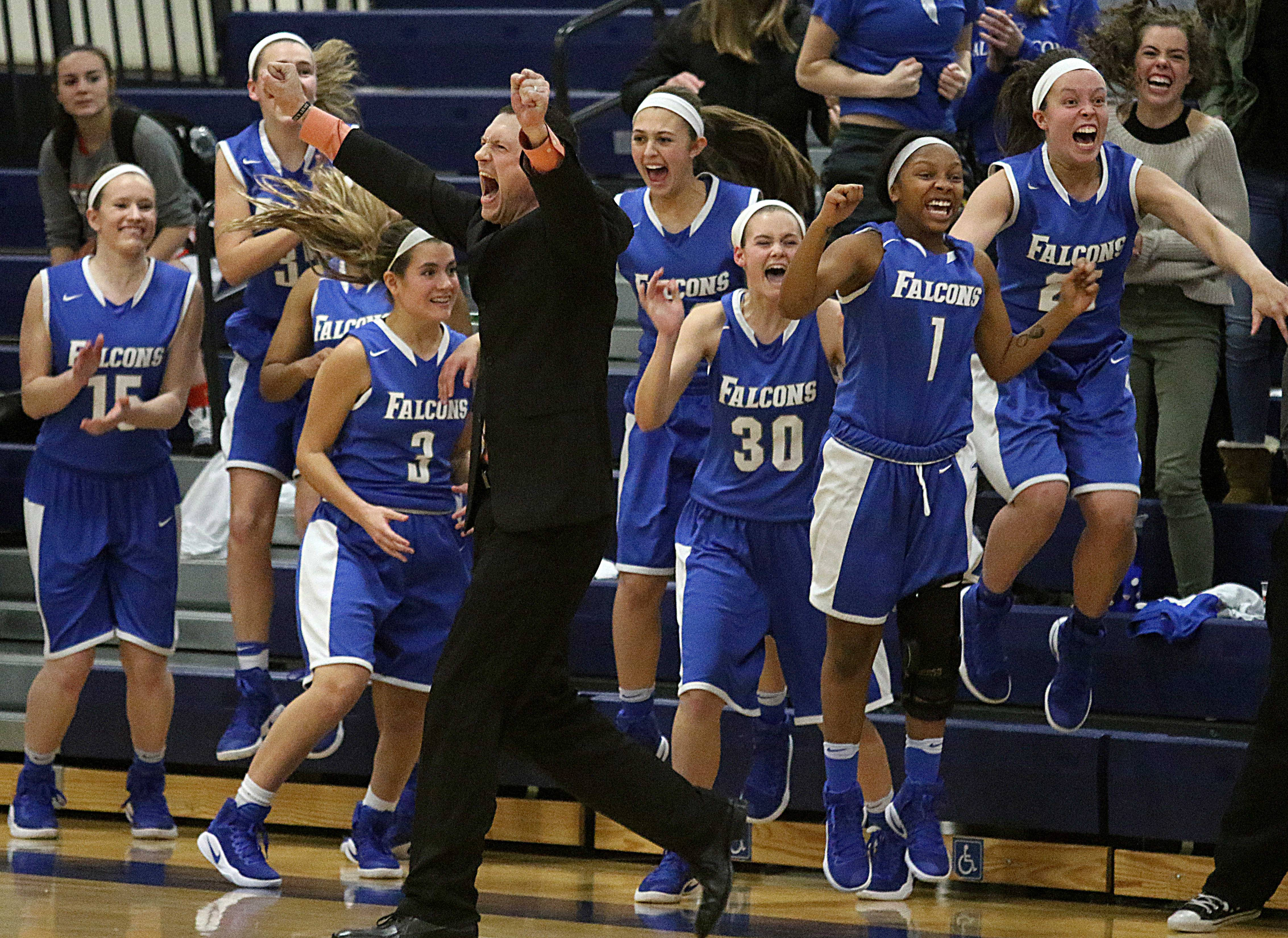 Wheaton North players, coaches and fans react as the Falcons win in overtime over Lyons Township in a semifinal of the 33rd annual Bill Neibch Falcon Classic tournament at Wheaton North Wednesday night.