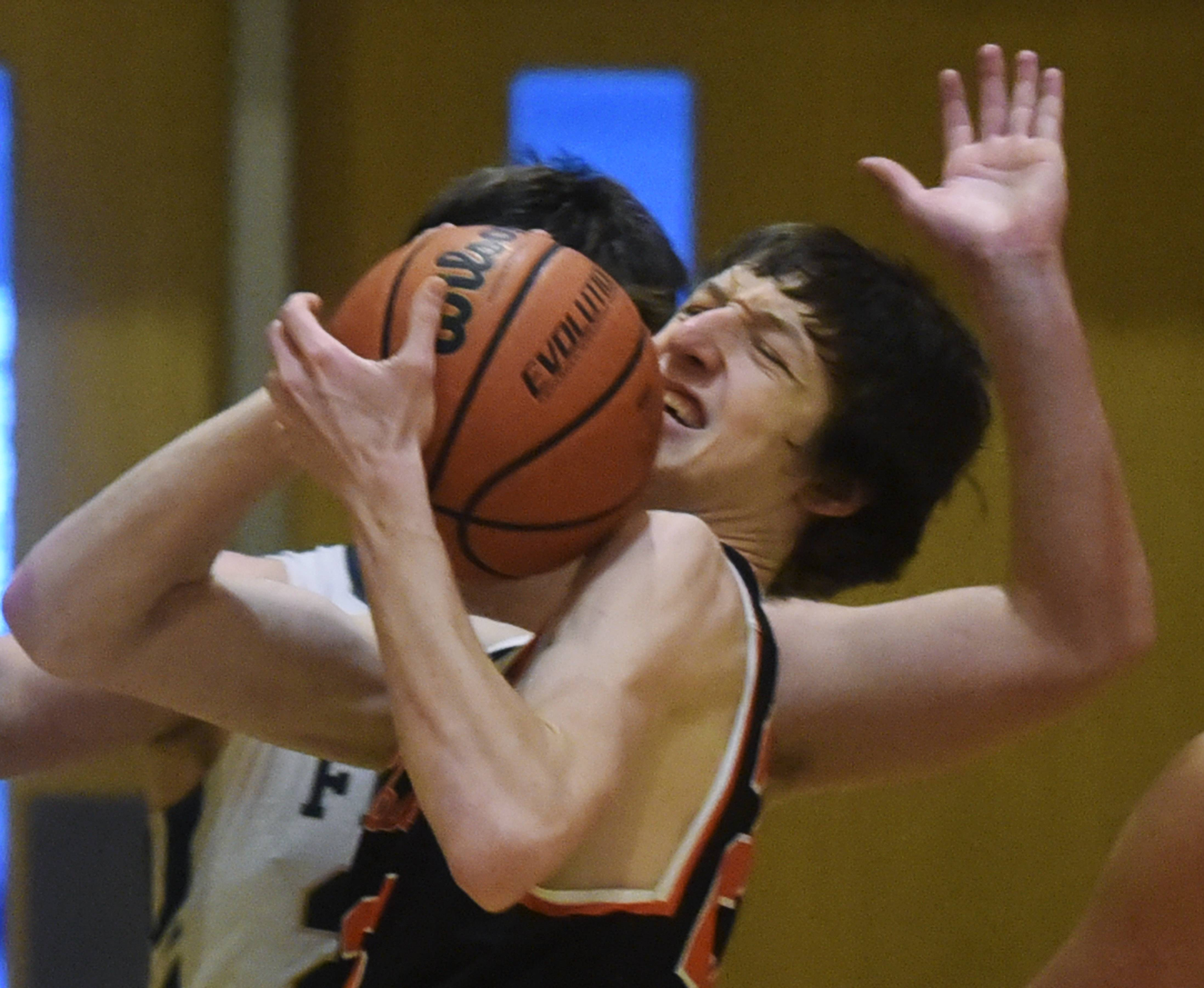 Libertyville's Drew Peterson maintains possession of the ball against Fremd during semifinal play in the Wheeling Hardwood Classic on Thursday.