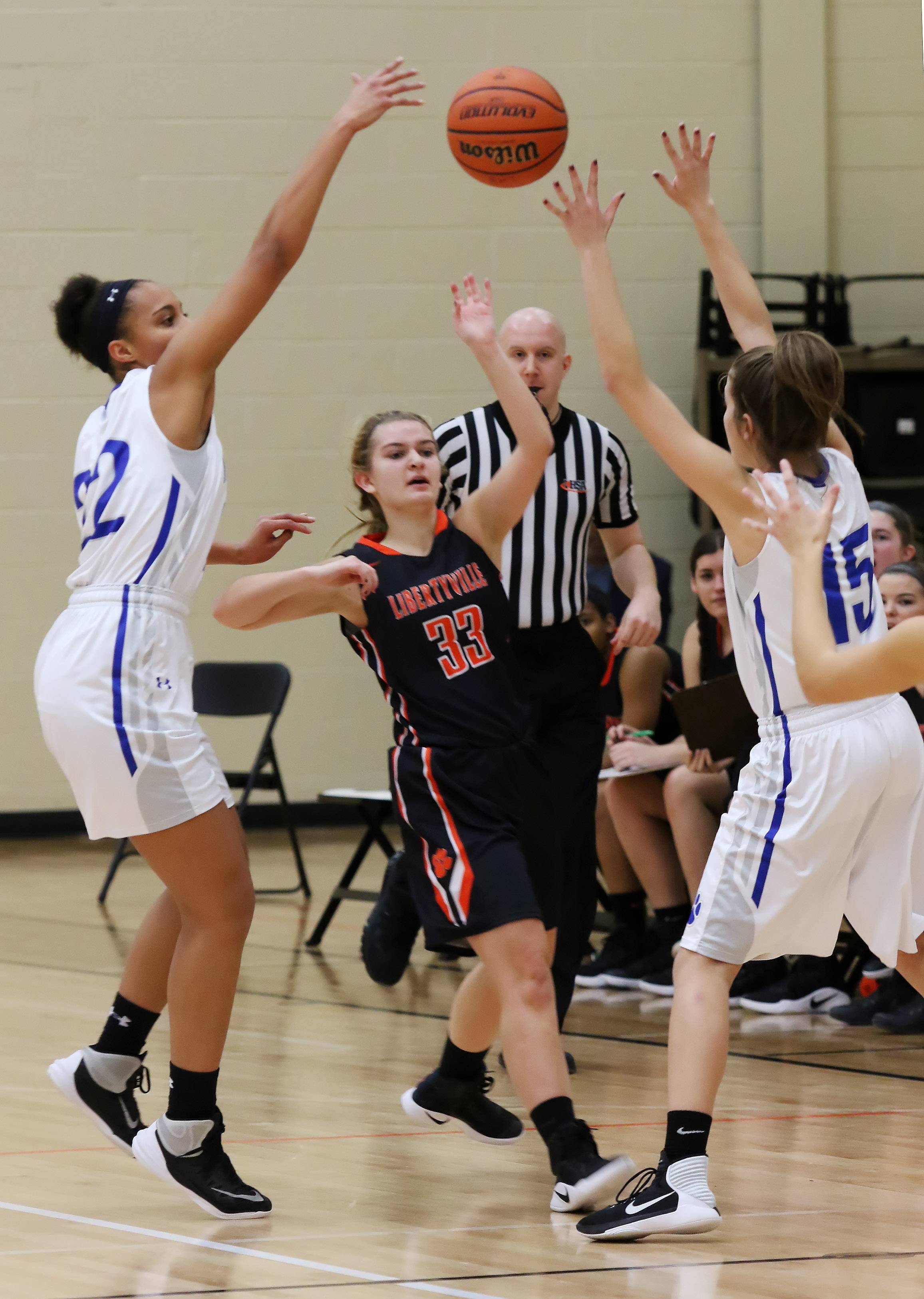 Libertyville guard Morgan Manski tries to pass out of double team with Vernon Hills' Kayla Caudle, left, and Kylie Bunning defending during tournament play Thursday at Libertyville.