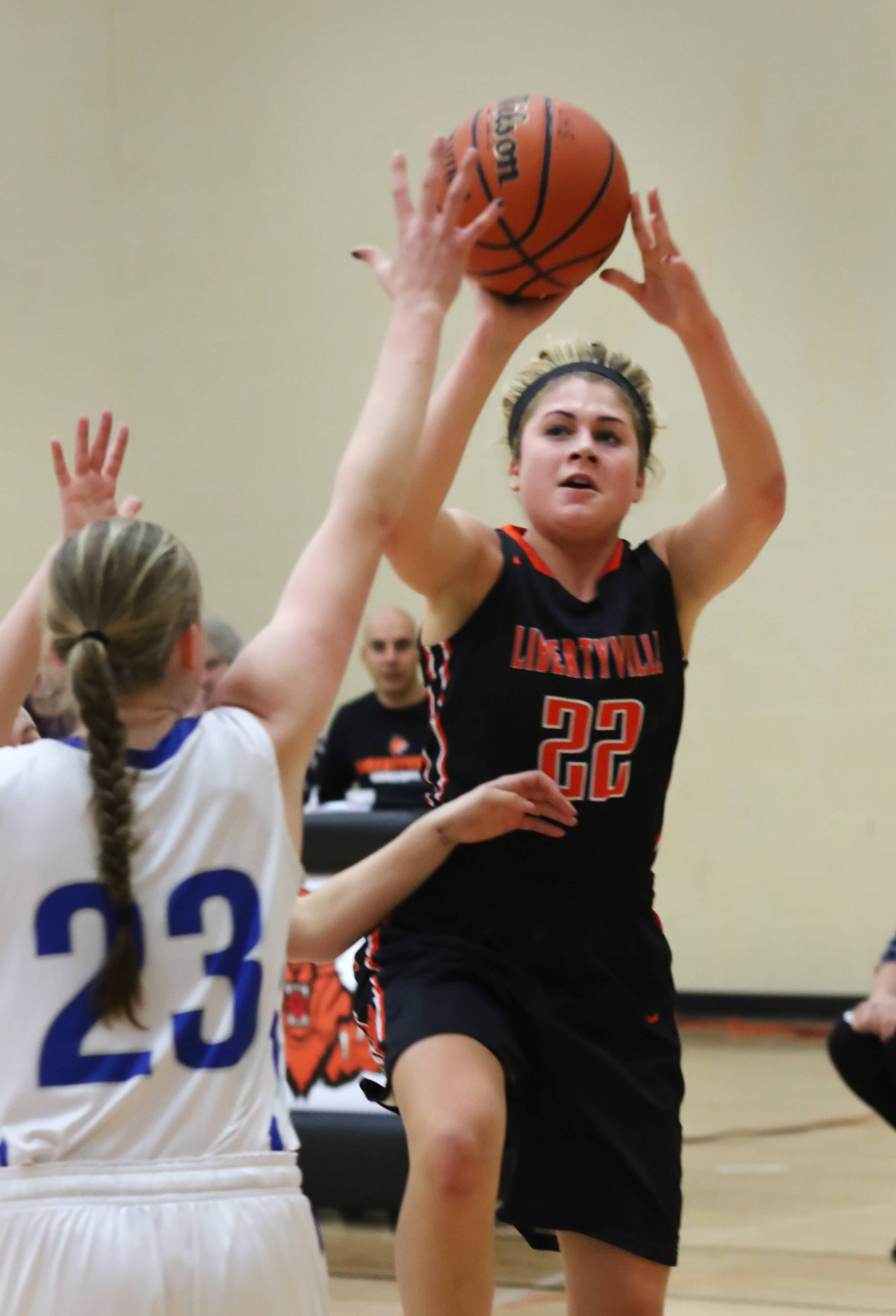 Libertyville guard Riley Weis shoots over Vernon Hills forward Becky Bahlmann during tournament play Thursday at Libertyville.
