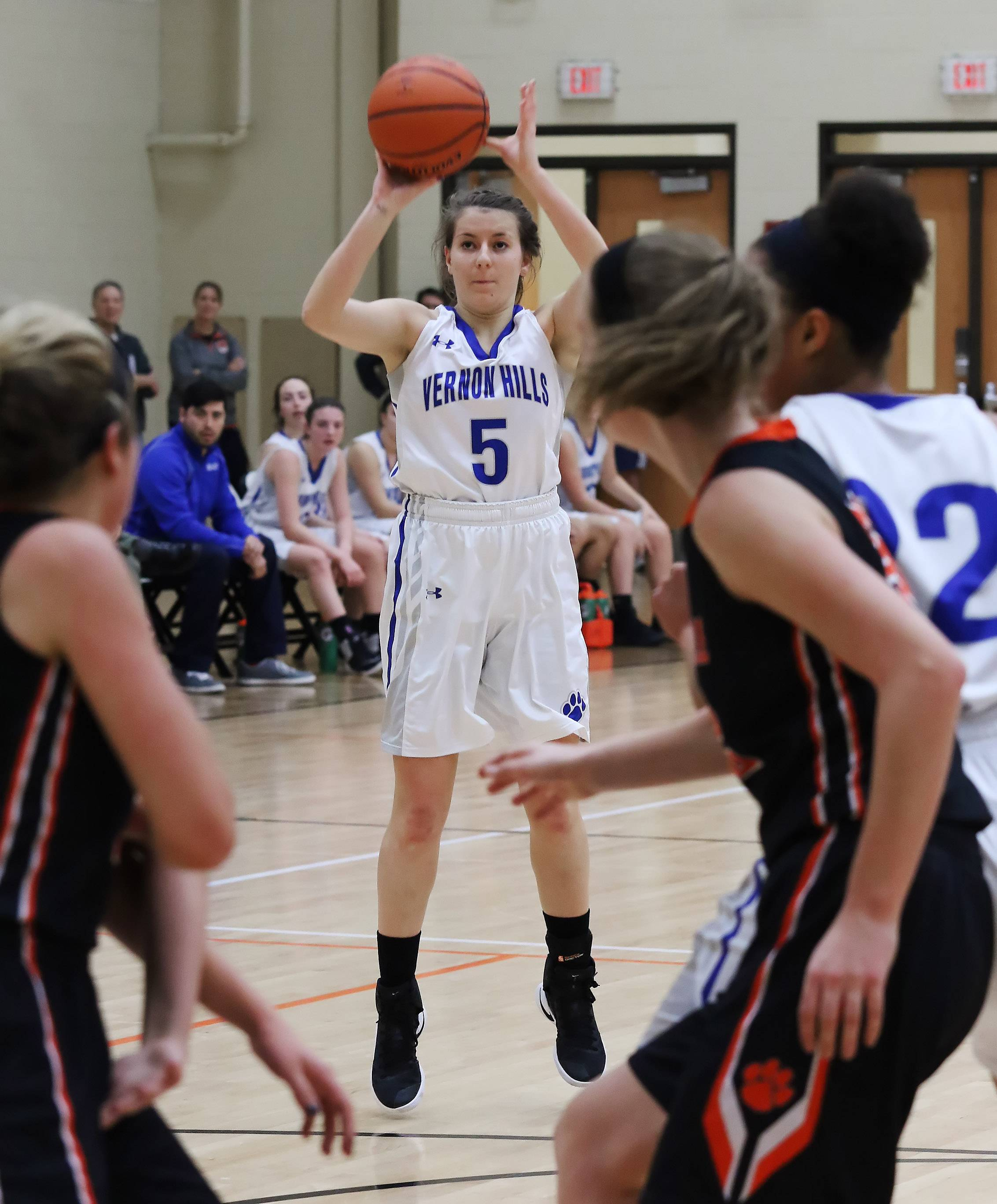 Vernon Hills guard Katie Burrows shoots a 3 against Libertyville during tournament play Thursday at Libertyville.
