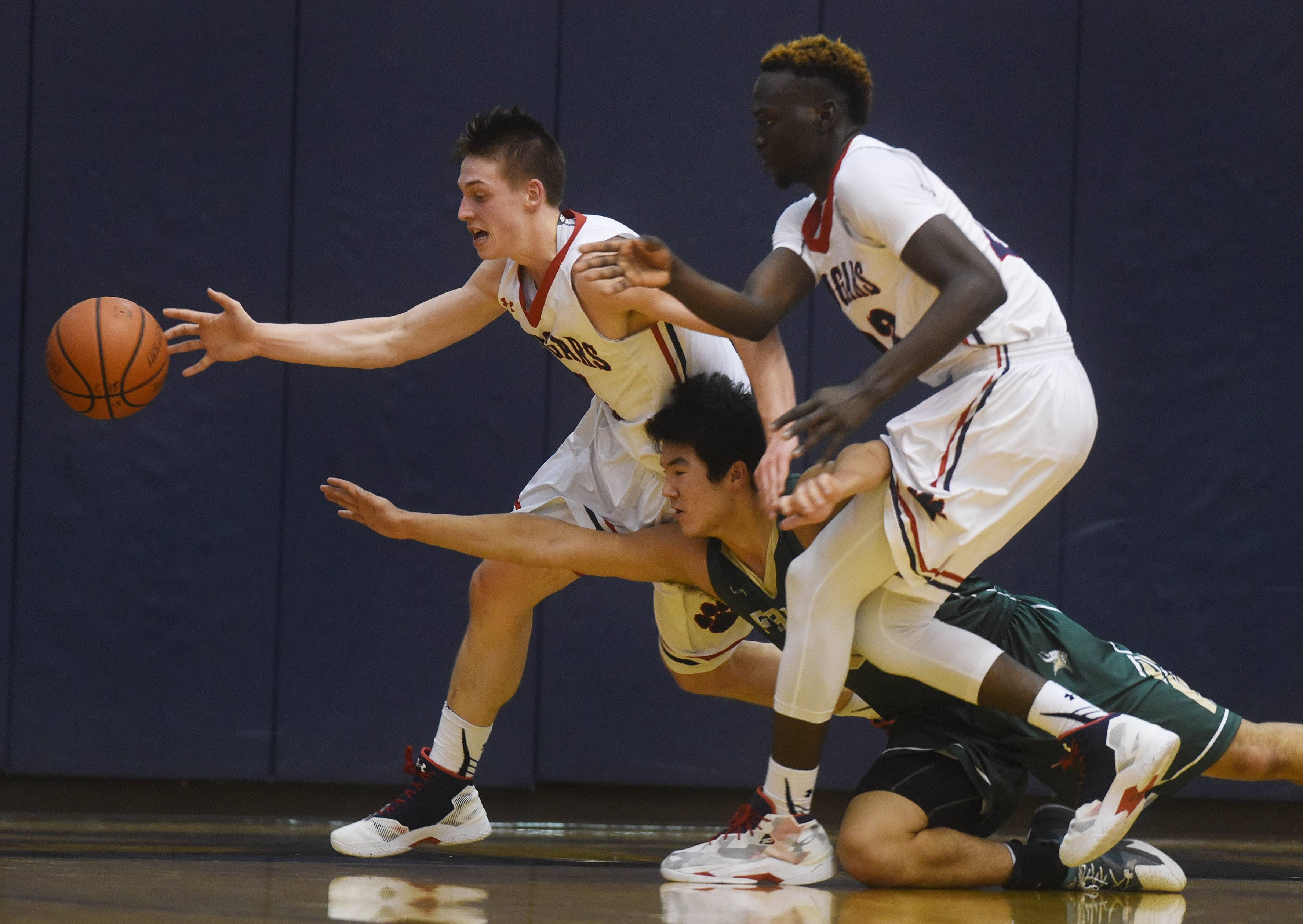 Conant's Jimmy Sotos, left, and teammate Mike Downing, here chasing a loose ball in MSL West play against Fremd, helped lead the Cougars to York's Jack Tosh championship with a 49-35 victory over St. Patrick on Friday. Sotos was named tournament MVP, and Downing also made the all-tournament team.