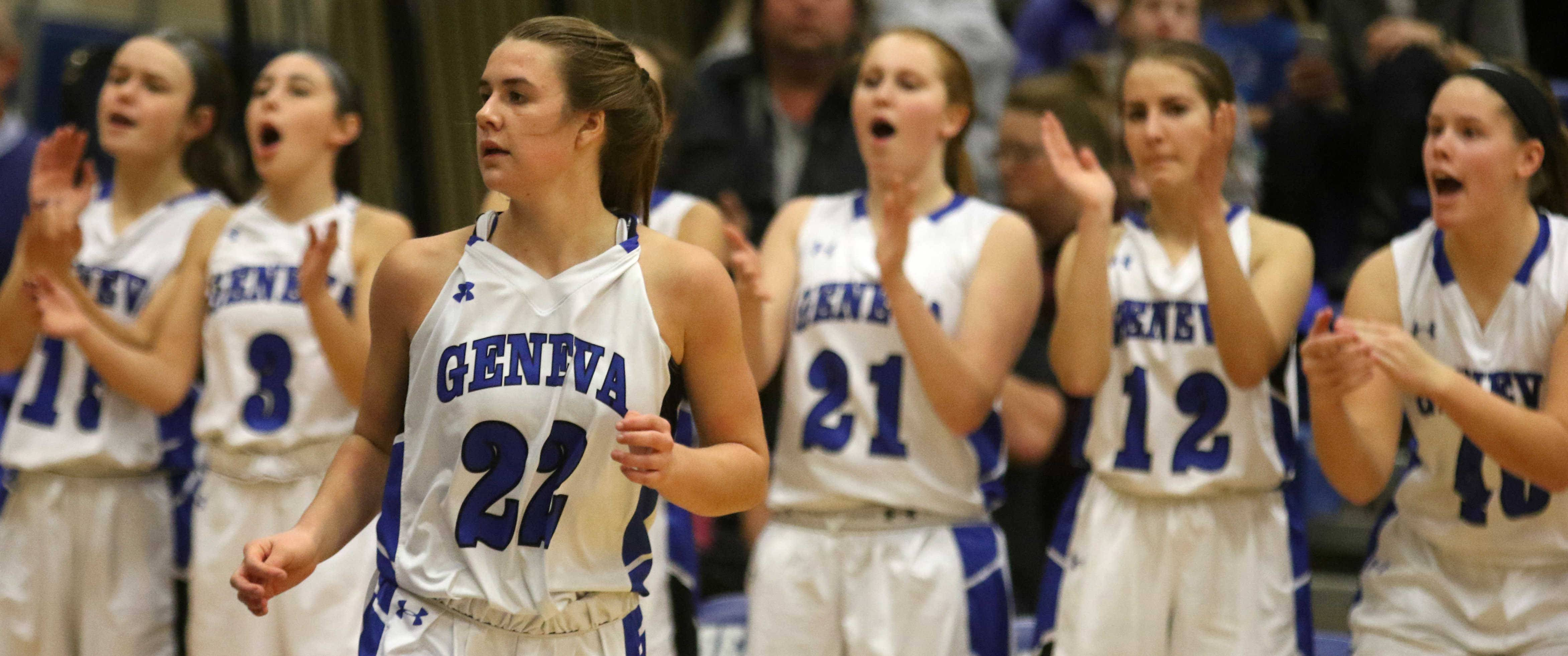 Geneva's Brie Borkowicz heads downcourt to the cheers of her teammates after she drained a 3-point basket against St. Charles North during varsity girls basketball at Geneva Friday night.