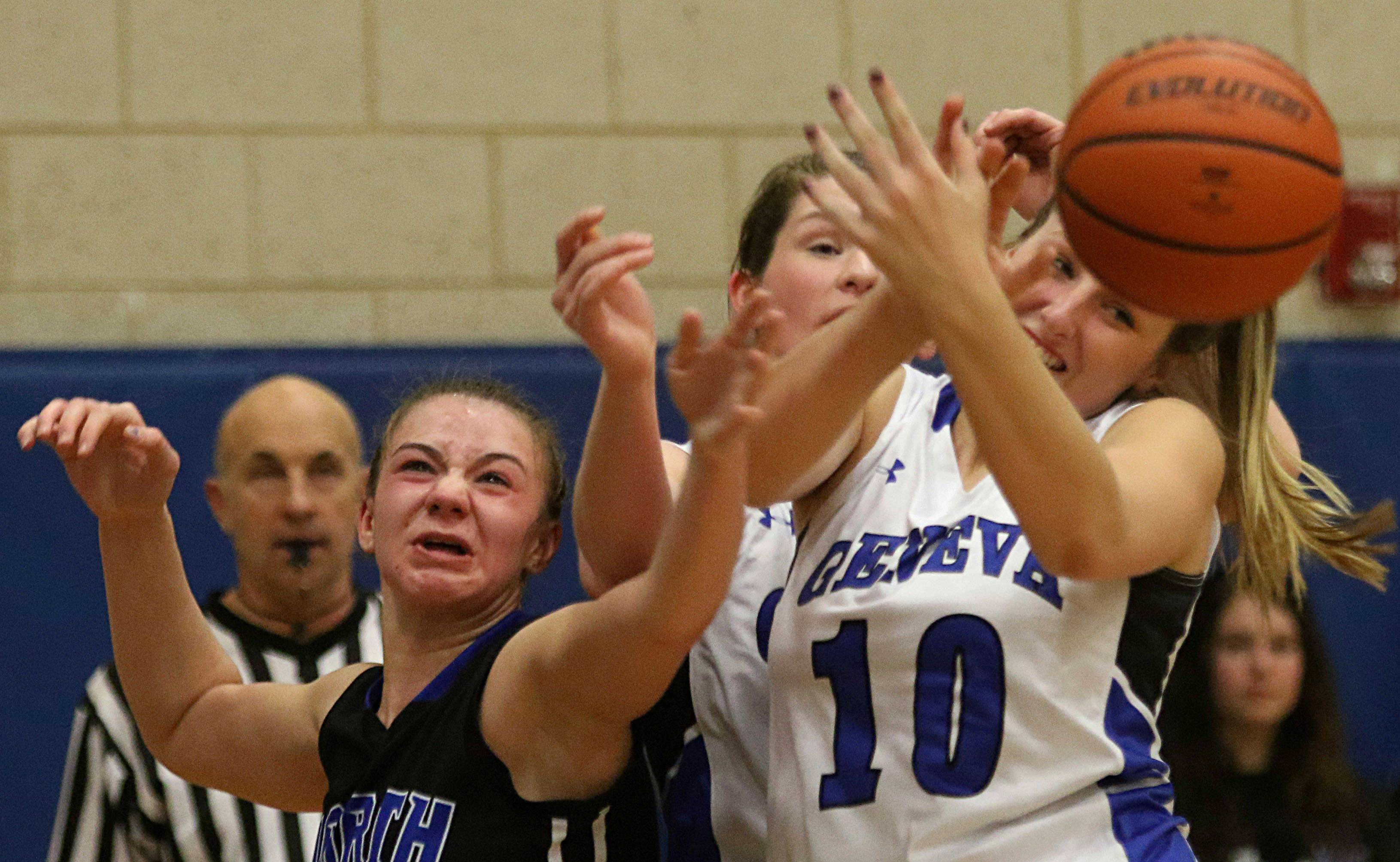 St. Charles North's Elizabeth Olsem, left, and Geneva's Grace Loberg battle for the ball during varsity girls basketball at Geneva Friday night.