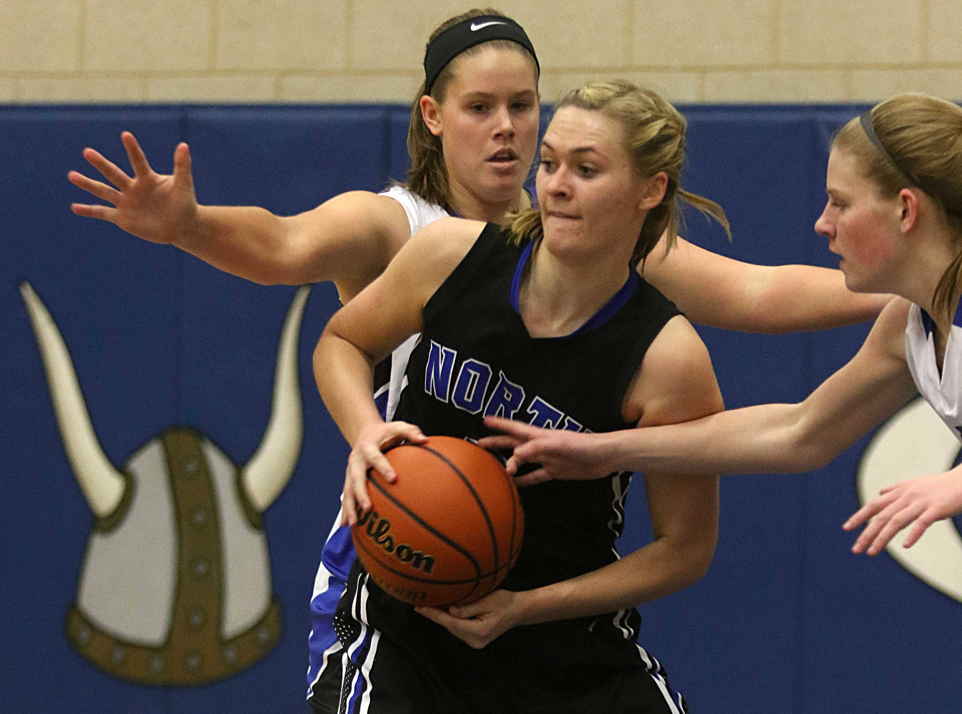 St. Charles North's Anna Davern tries to navigate her way through Geneva's defense during varsity girls basketball at Geneva Friday night.