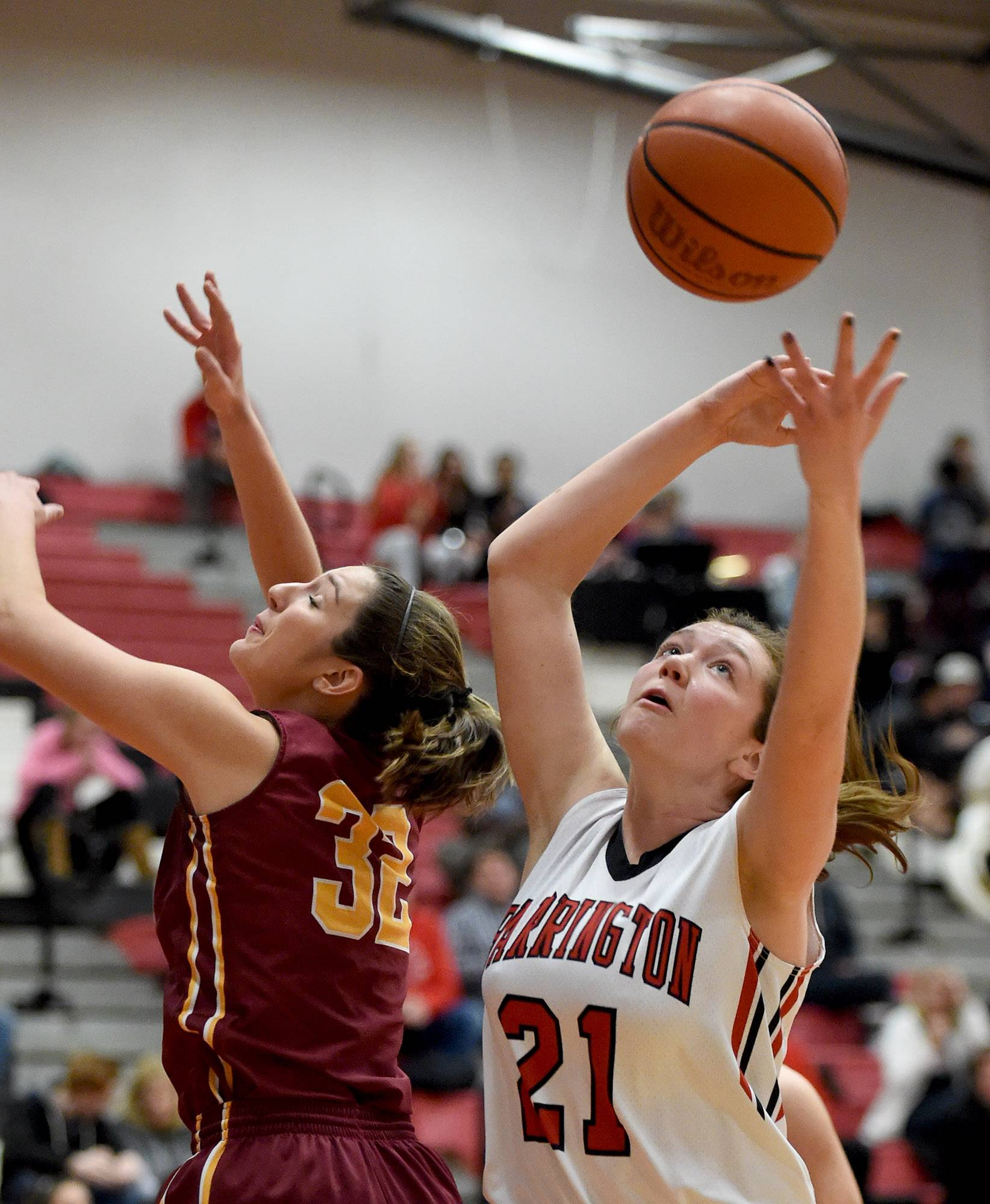 Barrington's Cecilia Stack (21) beats Schaumburg's Laura O'Connell (32) to a rebound Friday at Barrington.