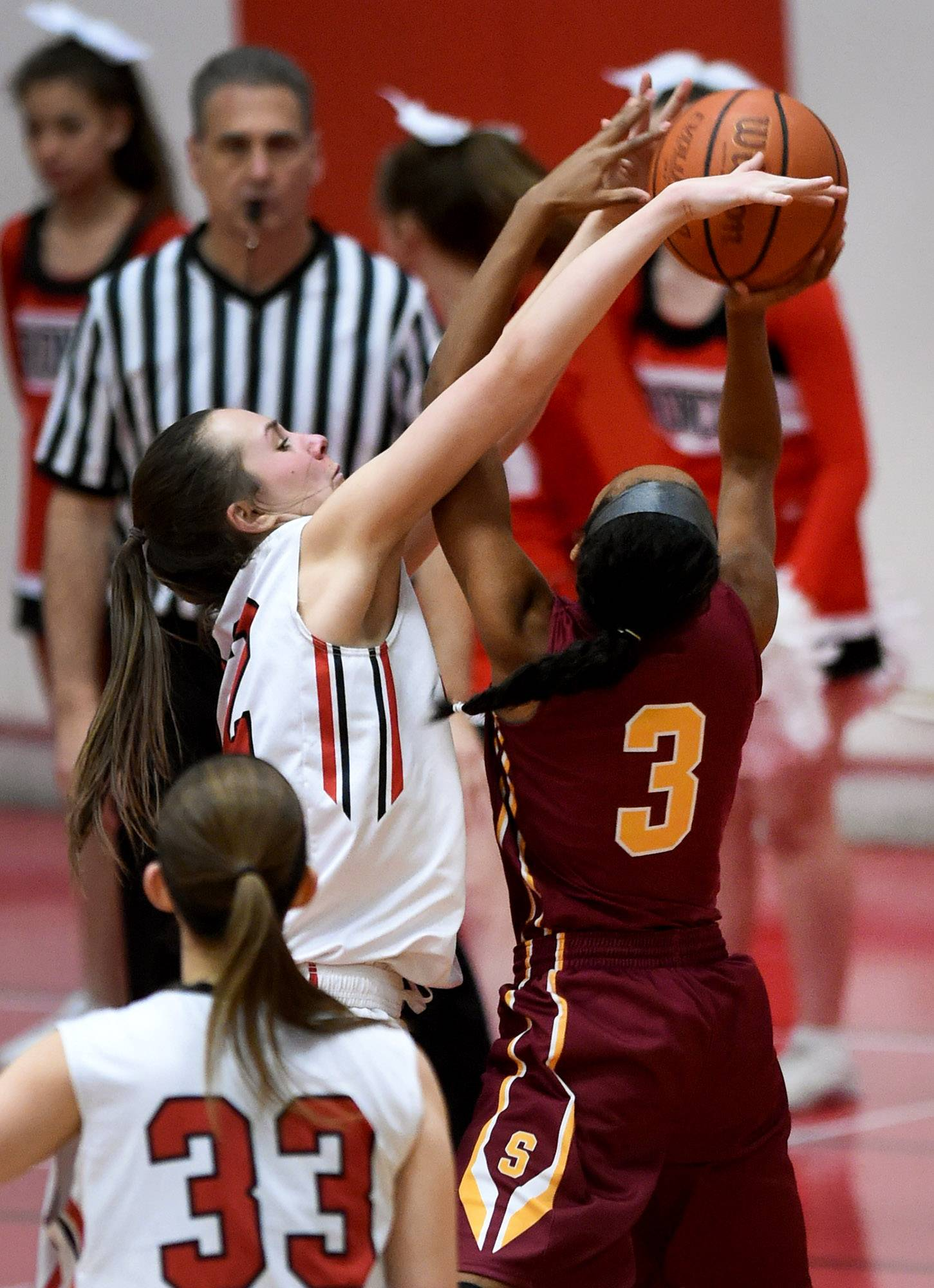 Barrington's Tess Conforti cleanly blocks a shot from Schaumburg's Kayla Patterson on Friday at Barrington.