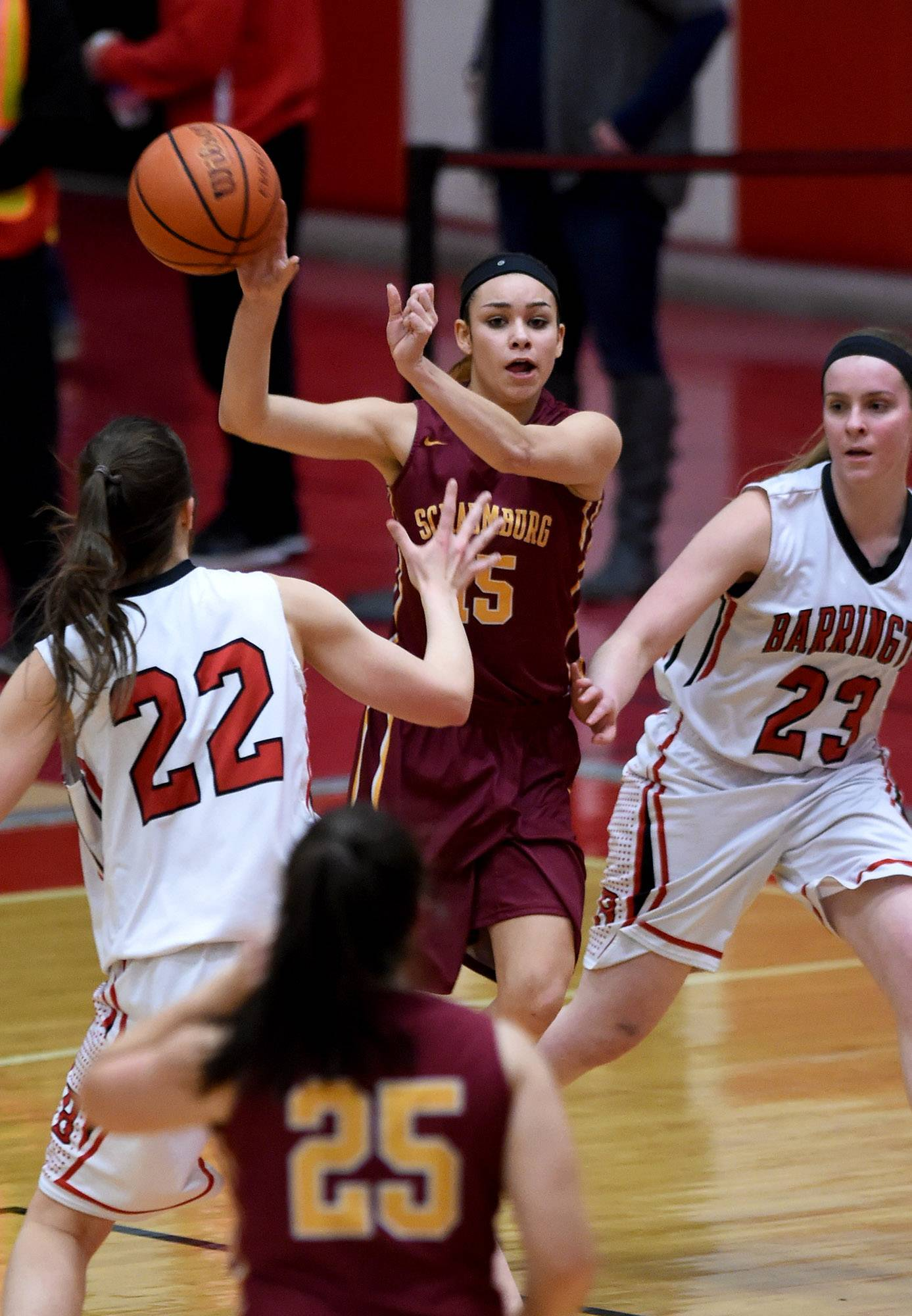 Schaumburg's Emmalyn Aguilar (15) gets doubled teamed in the corner and has to pass to teammate Abigail Paolicchi on Friday at Barrington.