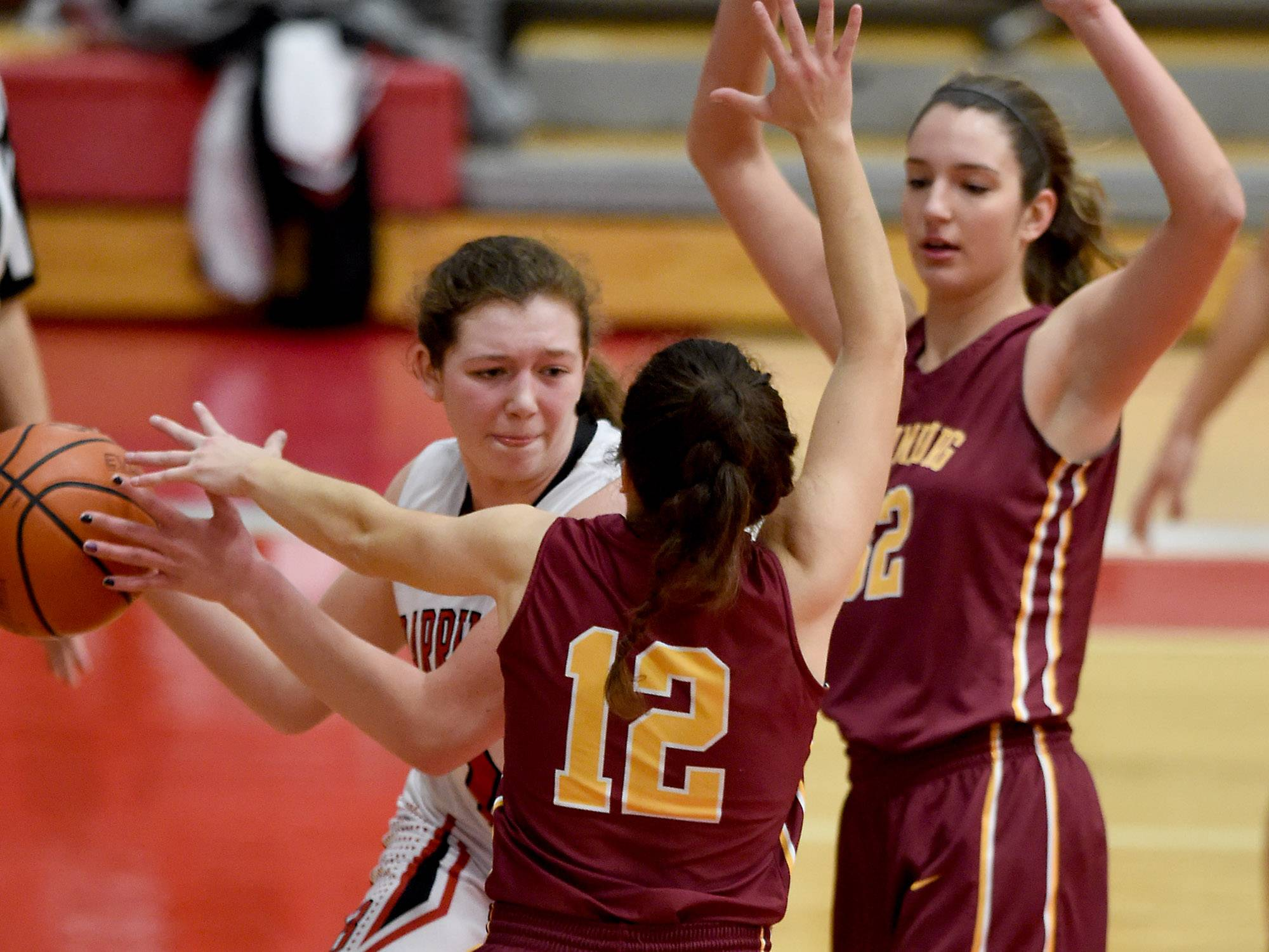 Barrington's Cecilia Stack (21) nearly gets trapped under her own basket by Schaumburg's Regina D'Orazio (12) on Friday at Barrington.