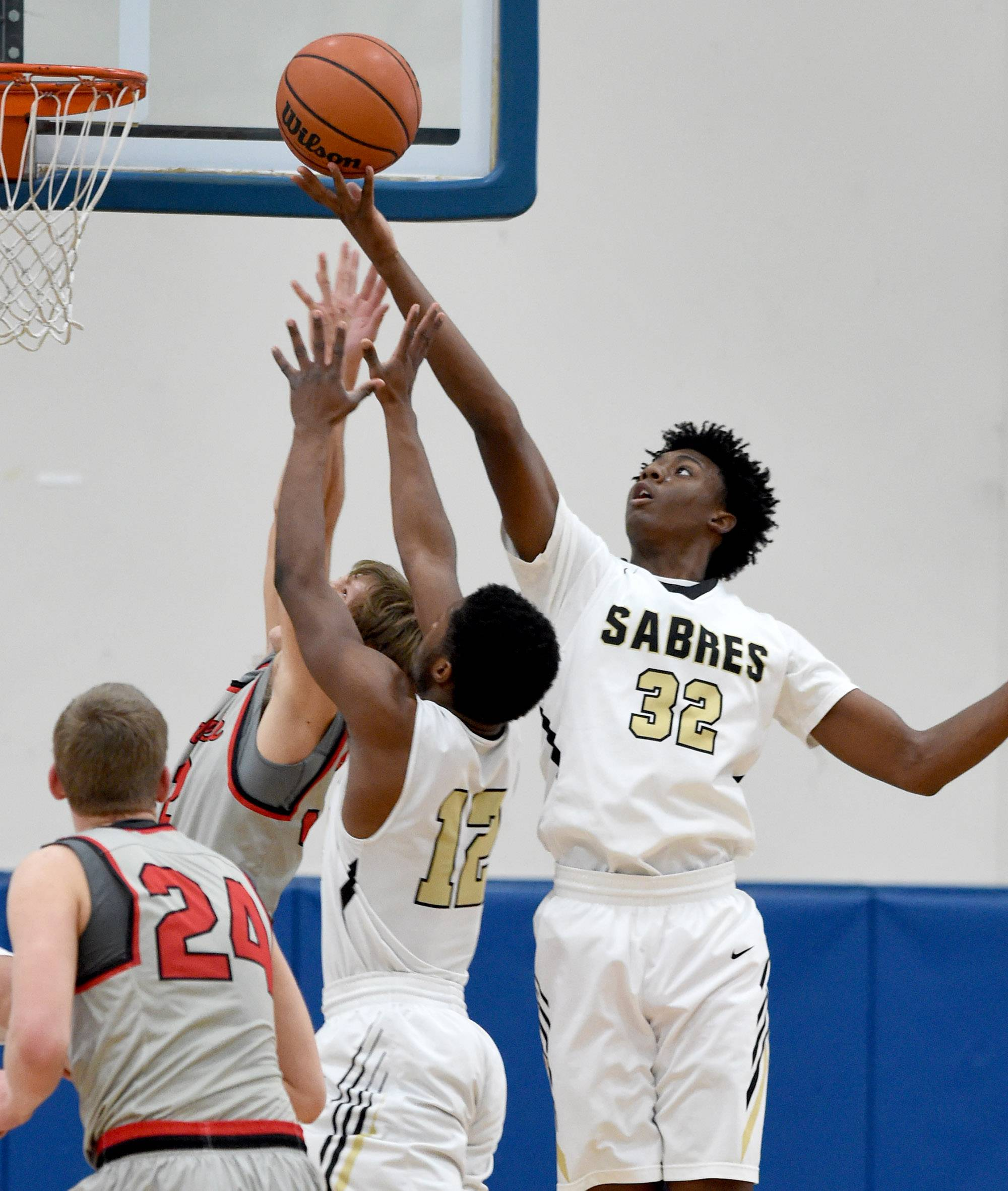Streamwood's Keenan Cole (32) reaches out and grabs a defensive rebound against Mundelein on Saturday at Lake Zurich.