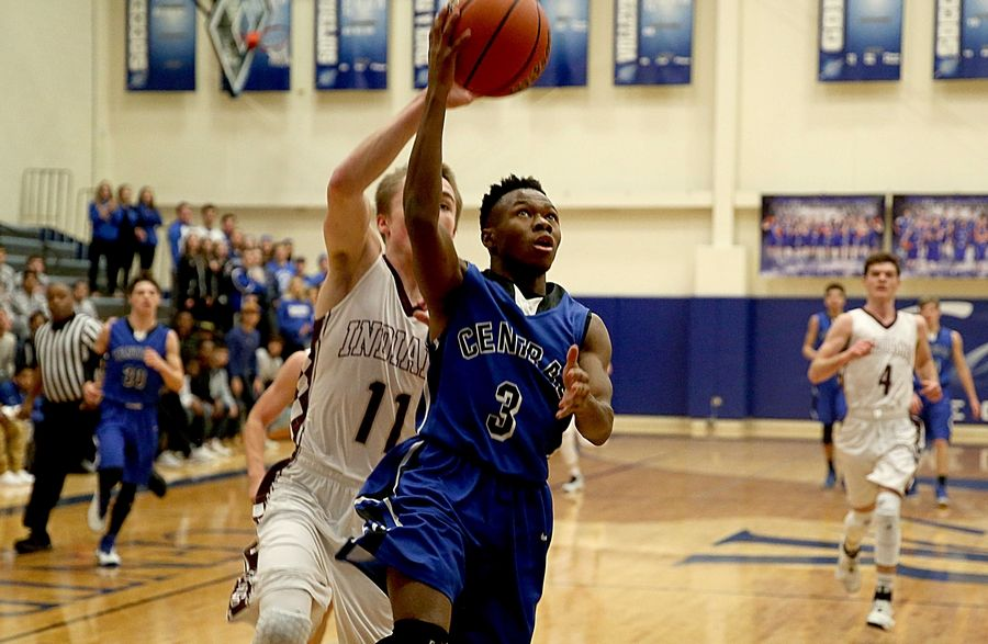 Burlington Central's TaVontae Harris scoots past Marengo's Michael Volkening en route to the hoop during the title game of the MLK Classic tournament at Burlington Monday night.