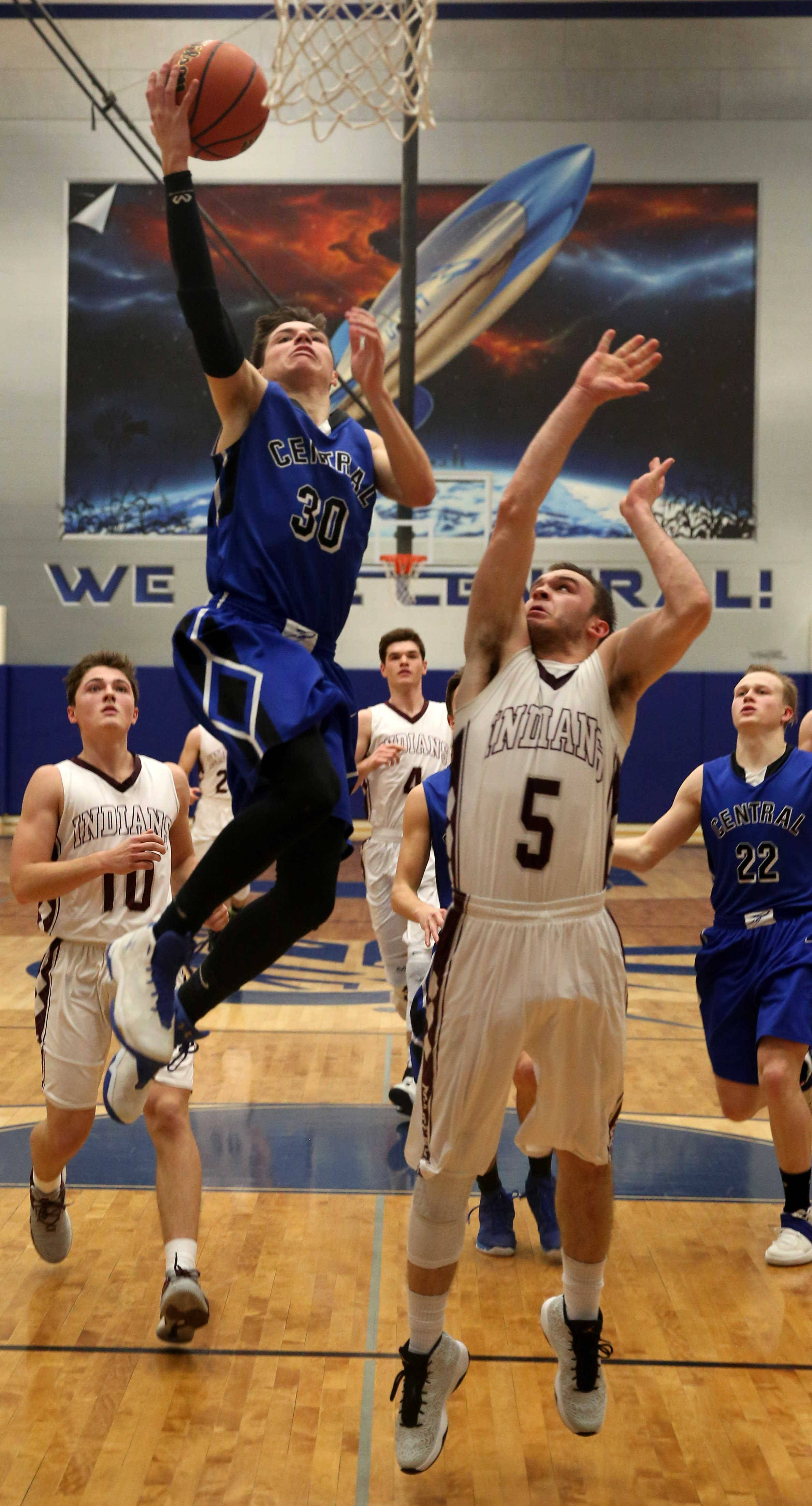 Burlington Central's Michael Kalusa soars past Marengo's Blaine Borhart during the title game of the MLK Classic tournament at Burlington Monday night.