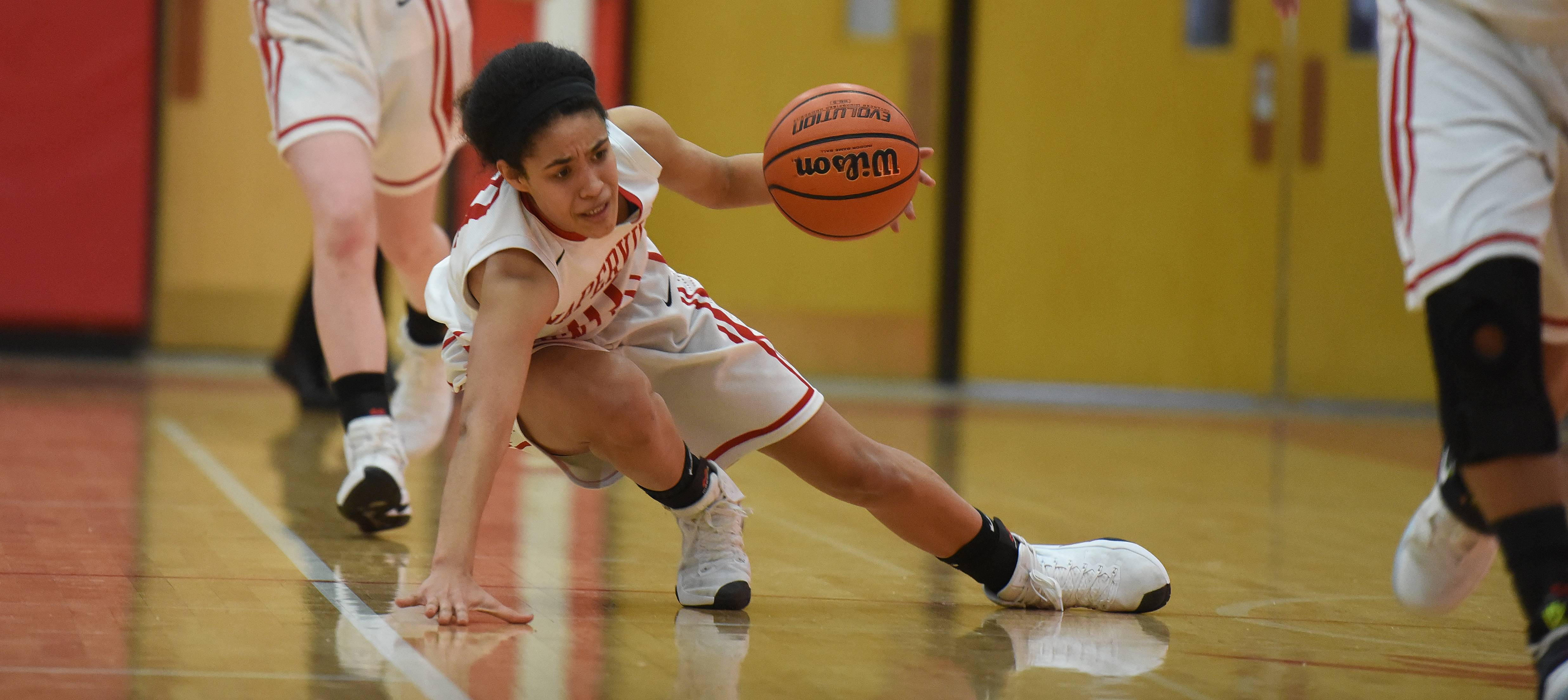 Naperville Central's Mia Lakstigala (31) drive the ball during the Metea Valley at Naperville Central girls basketball game Thursday.