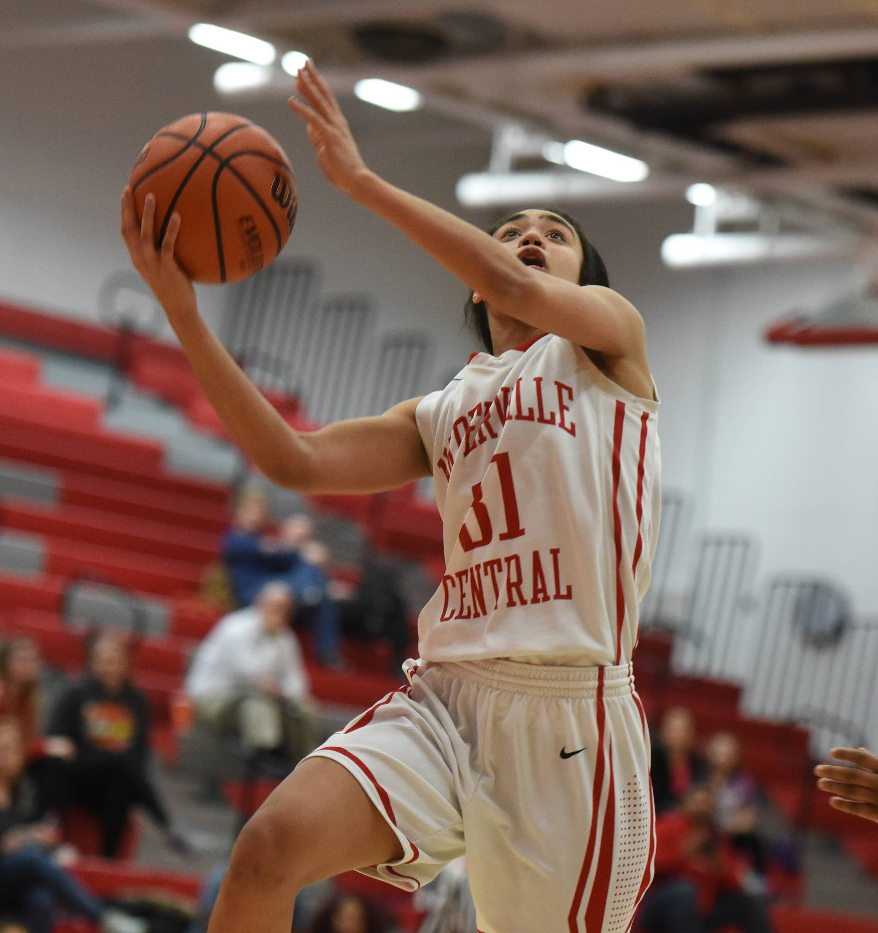 Naperville Central's Mia Lakstigala (31) takes one to the net during the Metea Valley at Naperville Central girls basketball game Thursday.