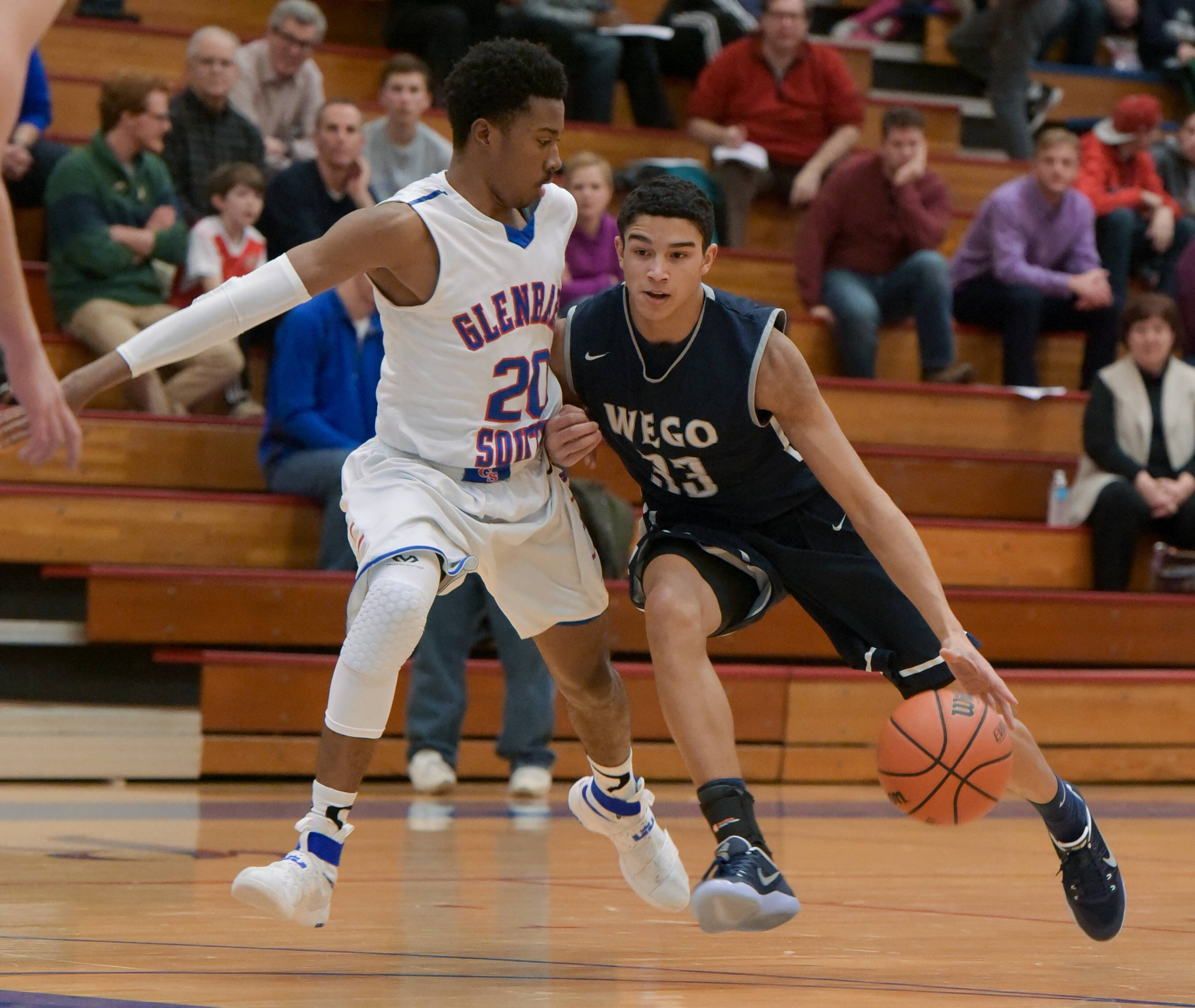 West Chicago's Tai Bibbs drives around Glenbard South's Brandon Whiteside during a game against Glenbard South.