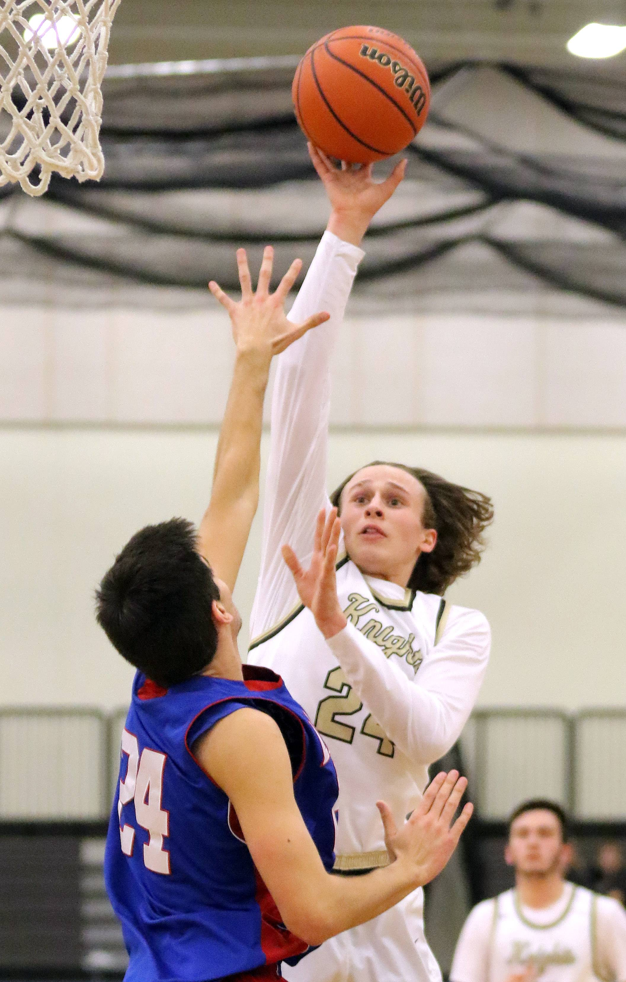 Grayslake North's Ryan Connolly, right, shoots over Lakes' Wade Parmly on Tuesday at Grayslake North.
