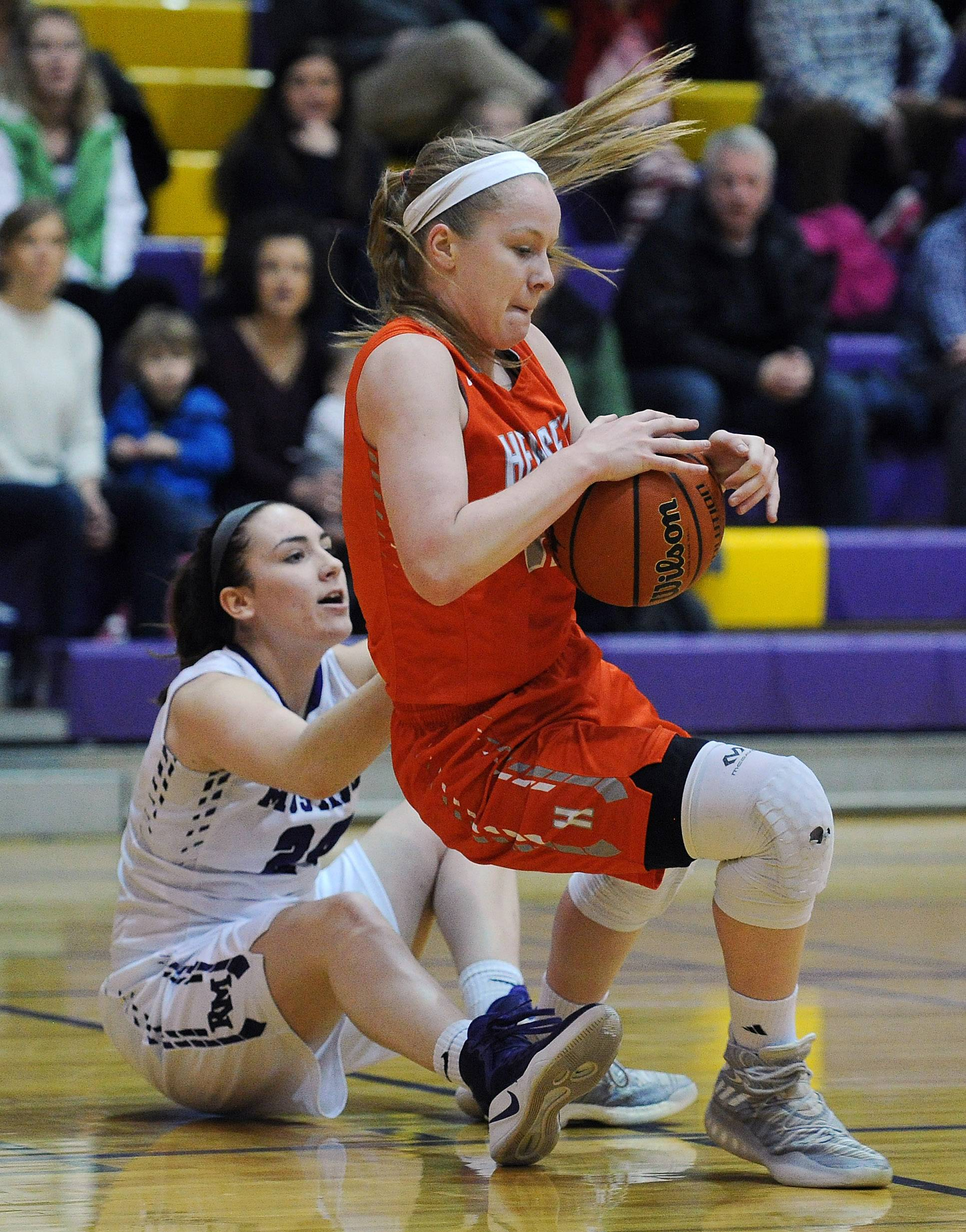 Hersey's Claire Gritt and Meadow's Caili Hosler battle for the ball on Friday at Rolling Meadows. The Huskies won 60-44 to clinch an outright MSL East championship.