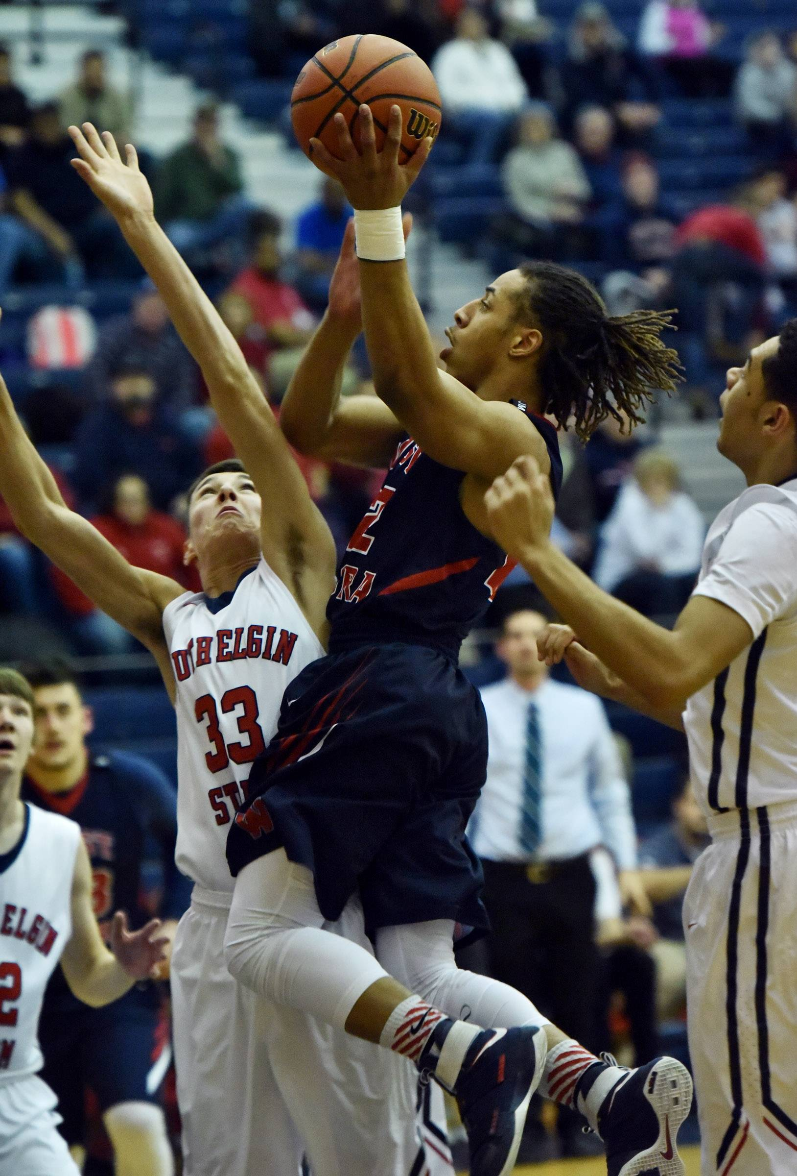 West Aurora's DaQuan Cross glides to the hoop against South Elgin's Vincent Miszkiewicz Friday in South Elgin.