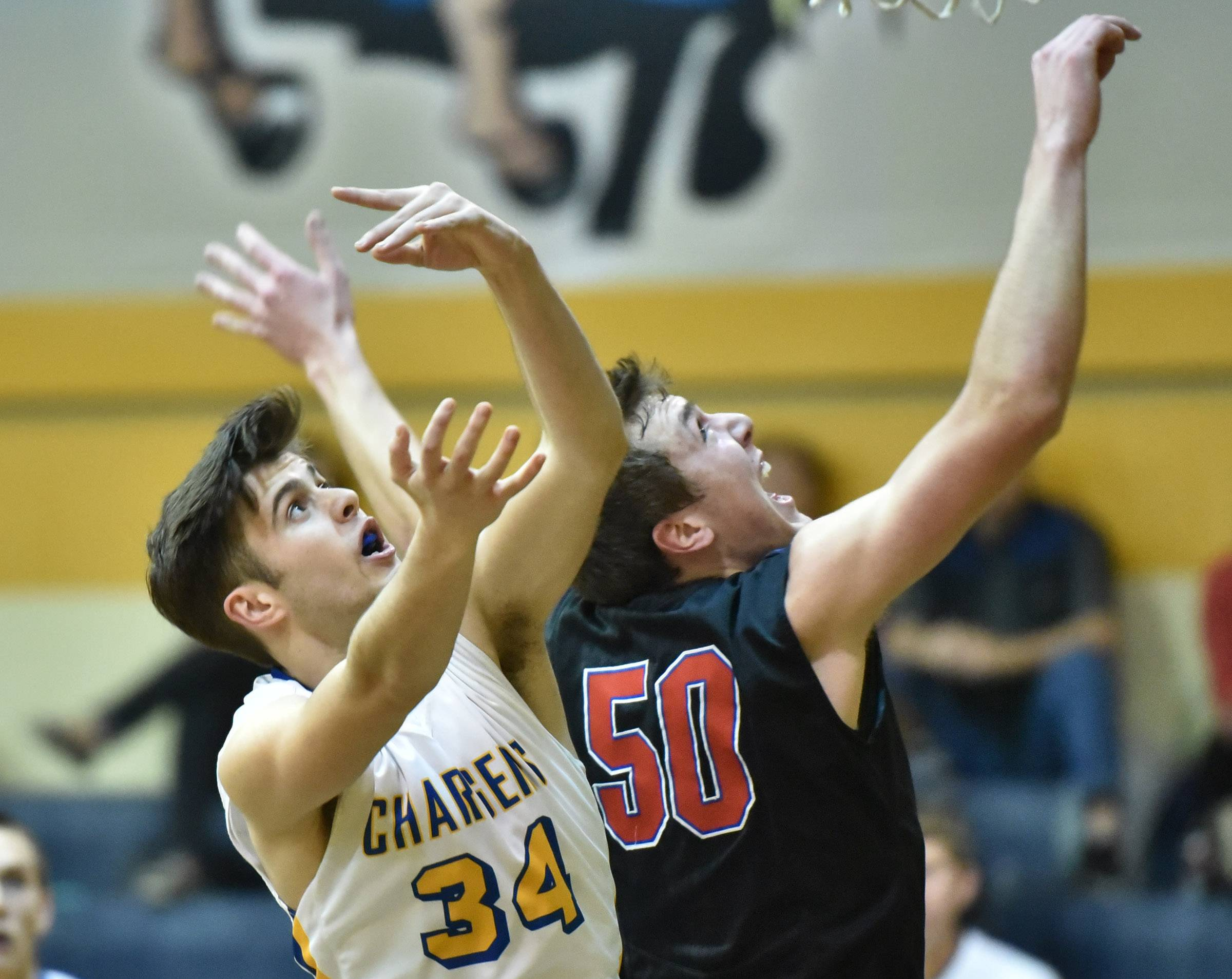 Aurora Central Catholic's Dru Ingraham and Glenbard South's Charlie Bair battle for a rebound Tuesday in Aurora.