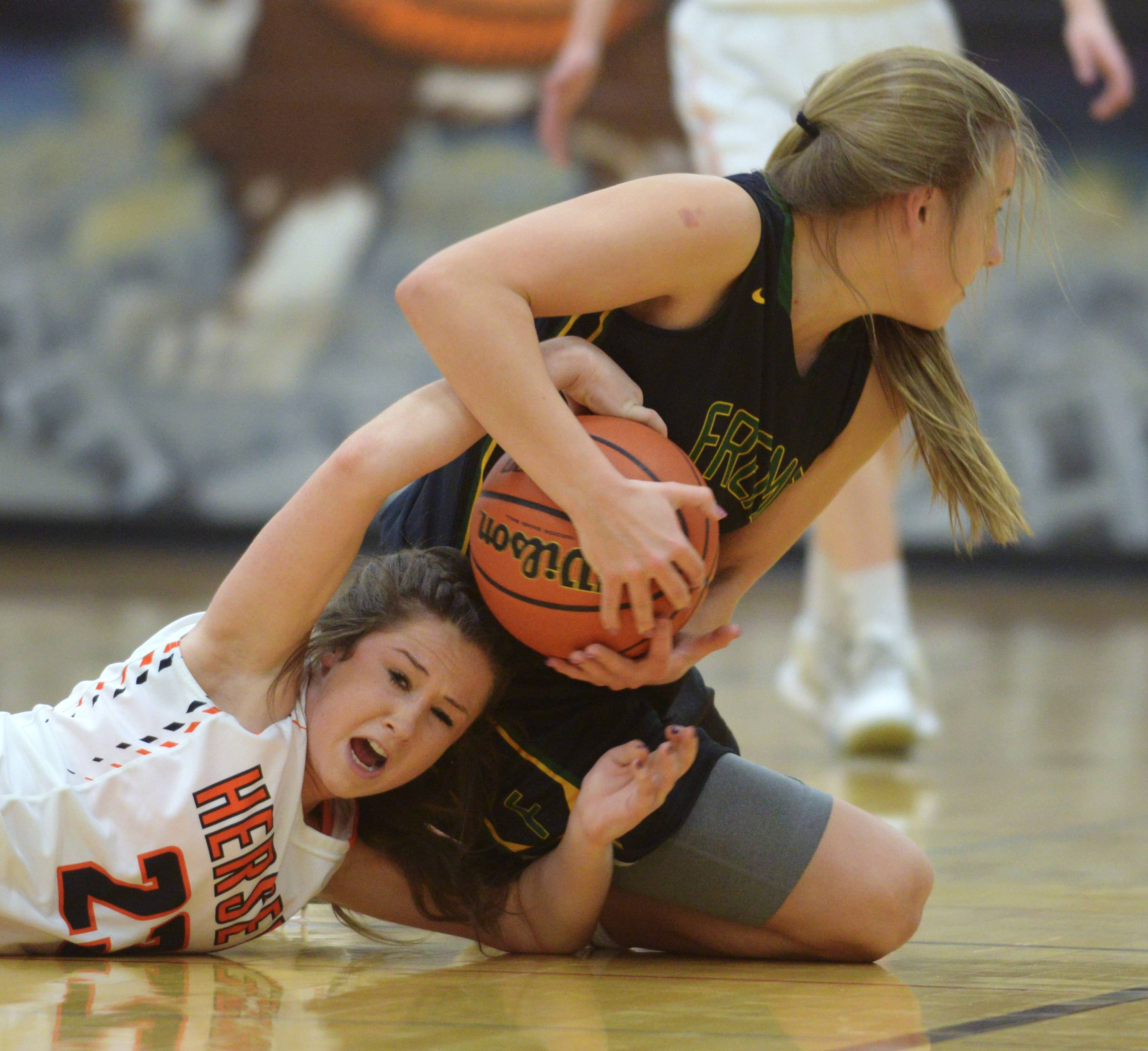 Hersey's Kelly Weyhrich, left, tries to take the ball from Fremd's Emily Klaczek during the Mid-Suburban League girls basketball championship game in Arlington Heights on Wednesday.