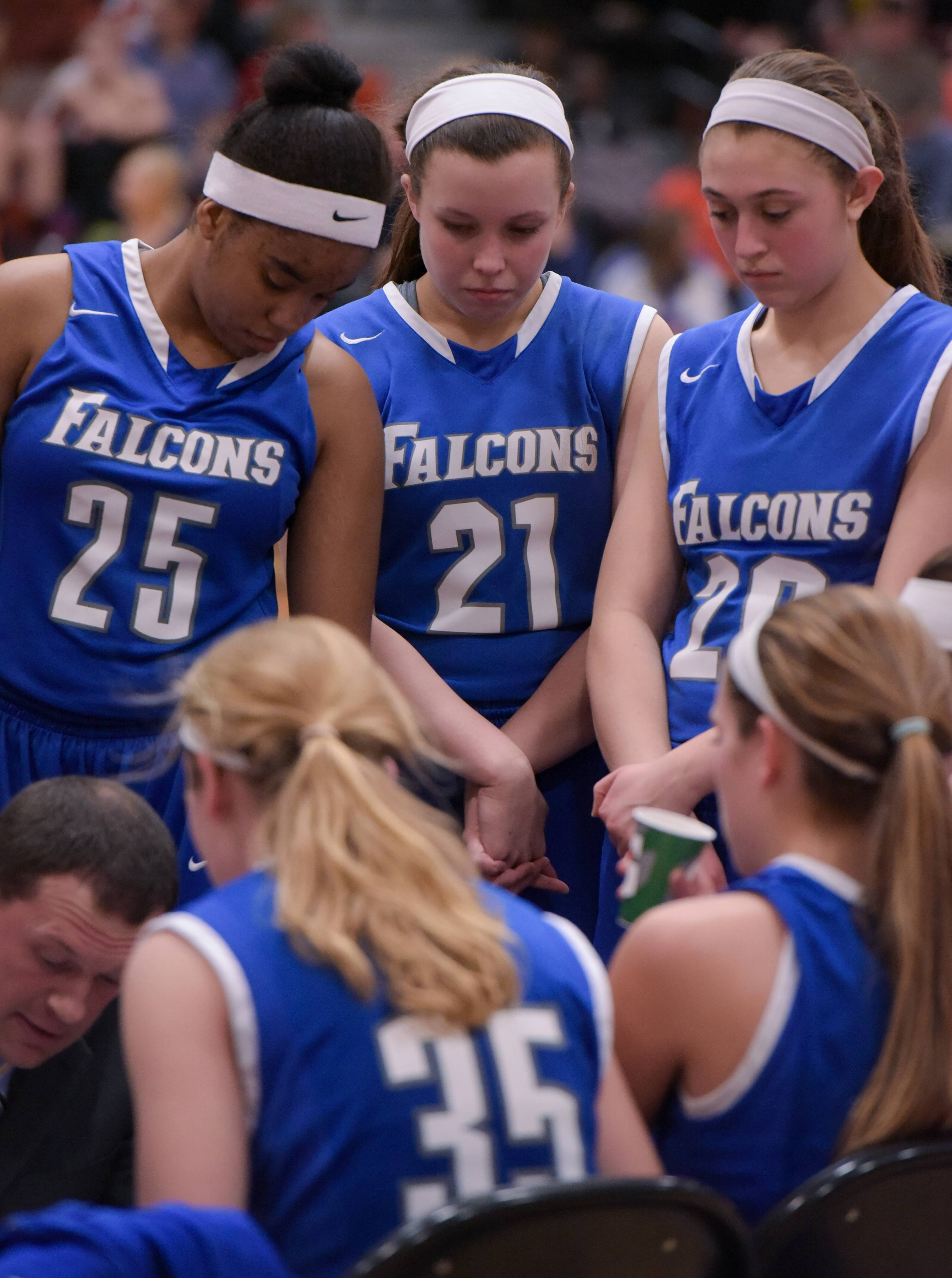 Wheaton North's Addy Lorentsen (21) listens in during a timeout against Wheaton Warrenville South on Tuesday in Wheaton.