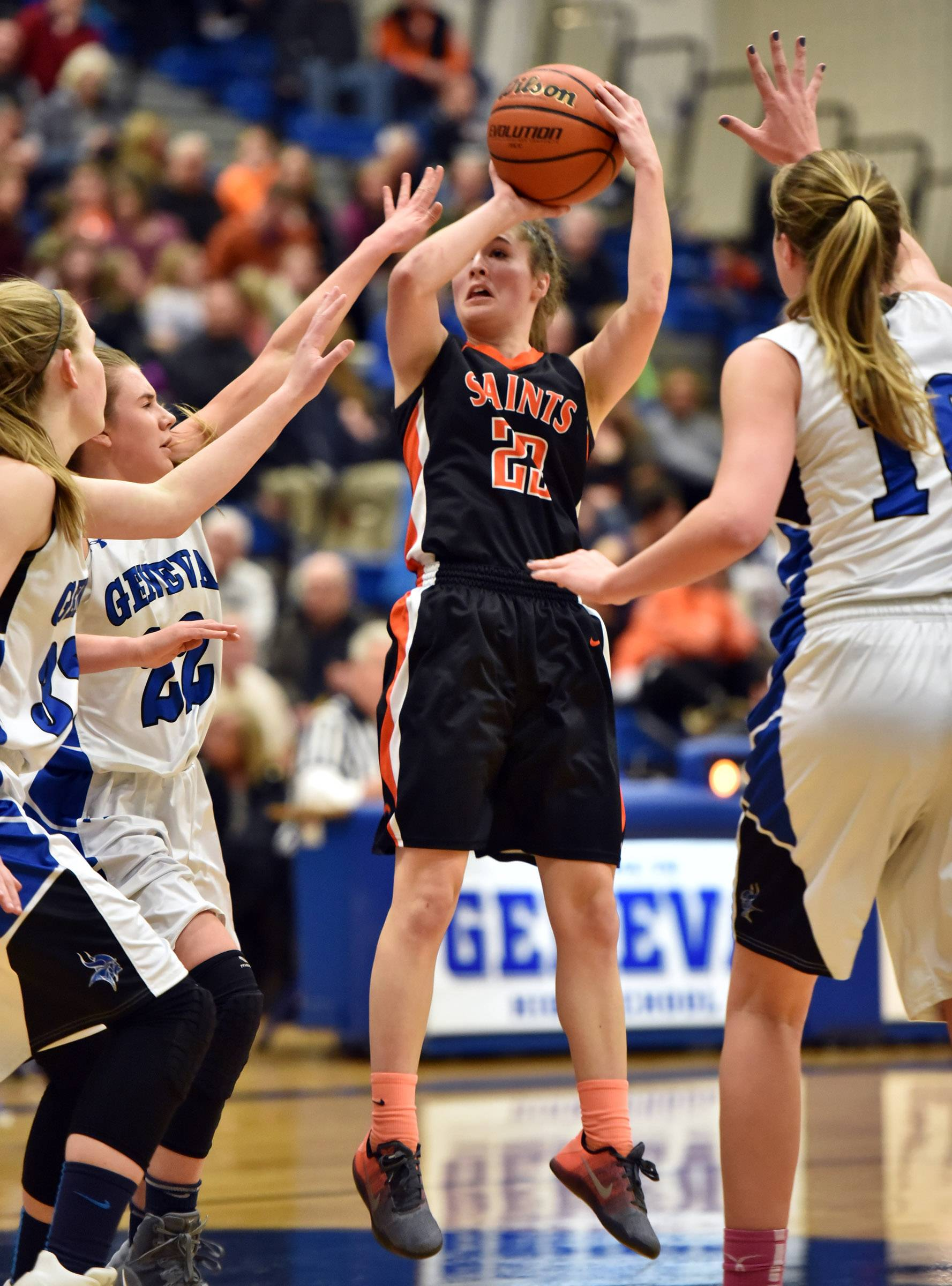 St. Charles East's Samantha Munroe shoots in a crowd of Geneva players Friday in Geneva.