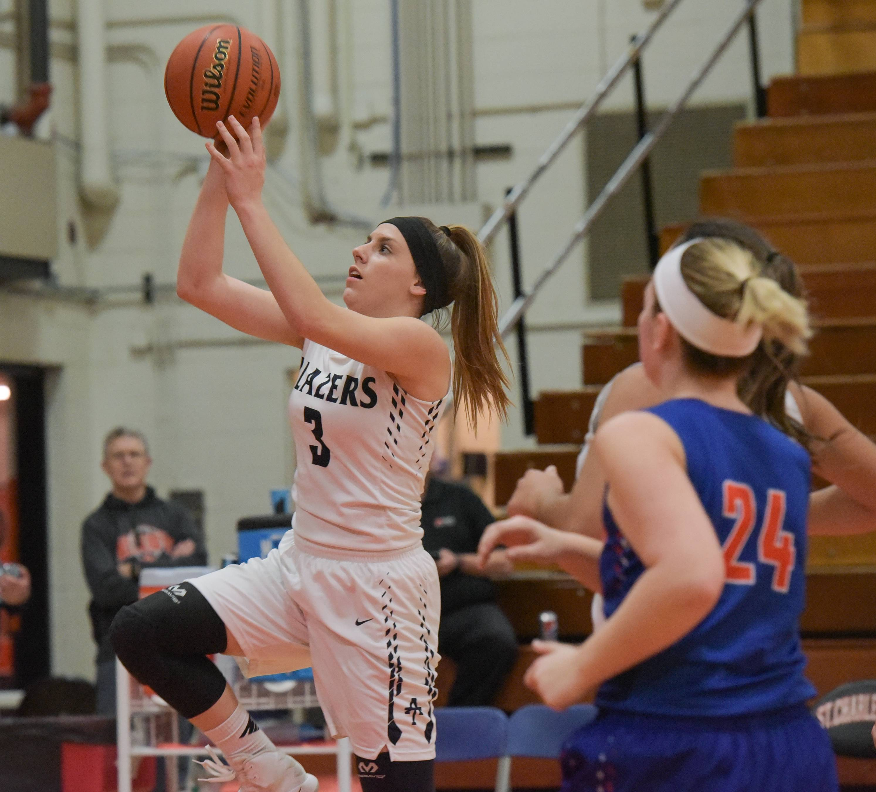 Addison Trail's Nicci Scorza lays up for a shot against Fenton during the girls regional quarterfinal basketball game February 13, 2017 at St. Charles East.
