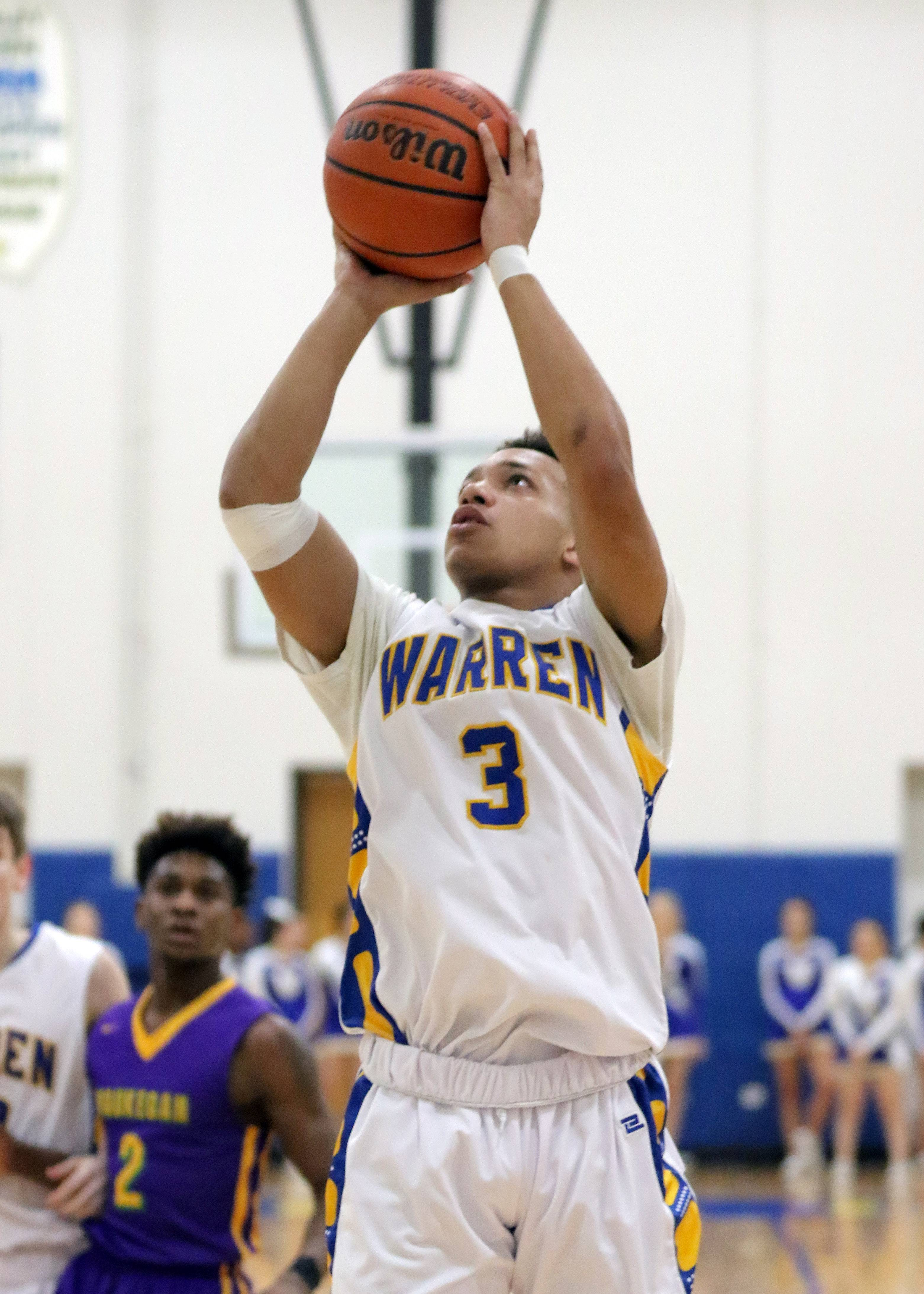 Warren's Jayson Dorsey pulls up for a jumper against Waukegan on Tuesday night in Gurnee.
