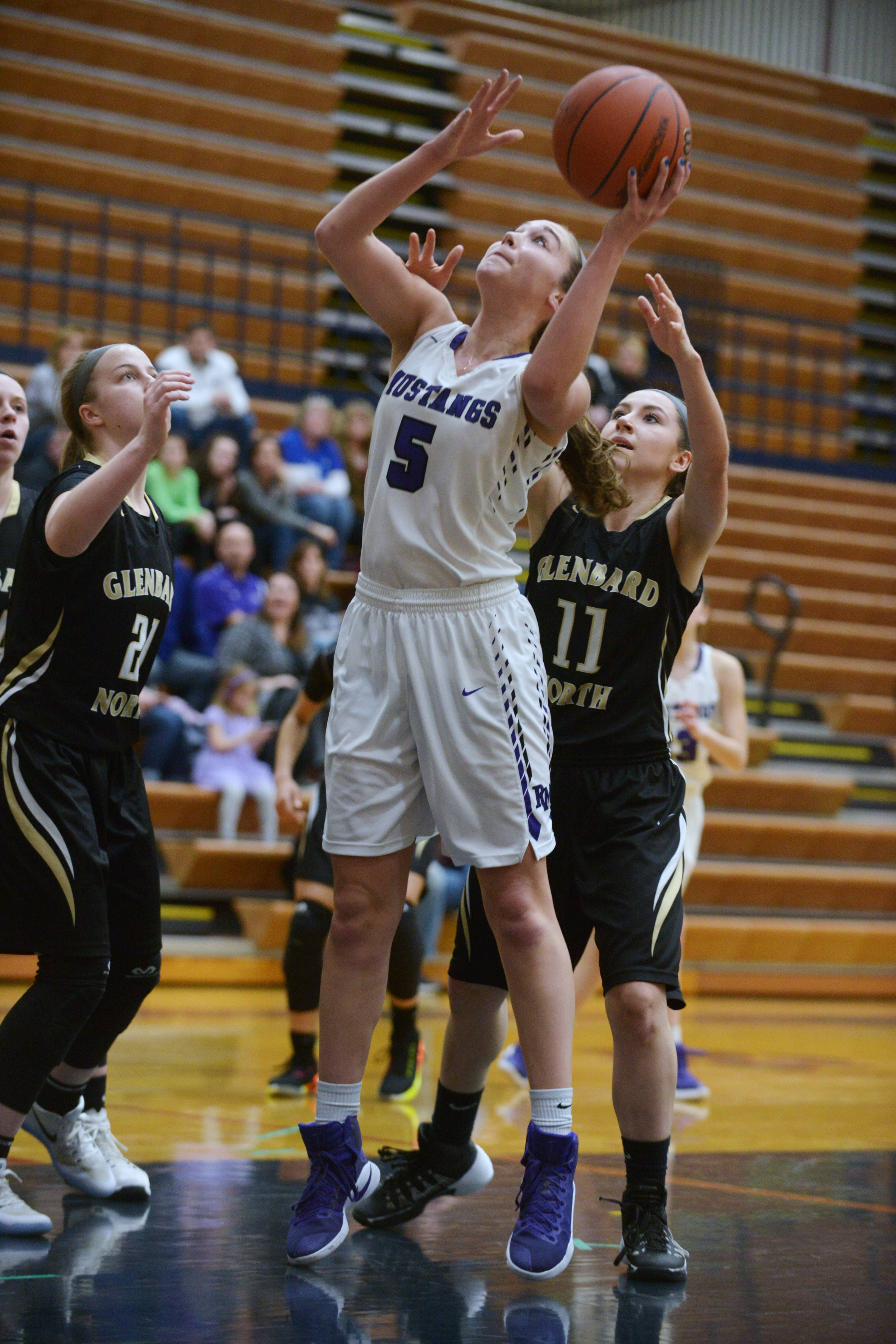Rolling Meadows' Kara Spiwak, middle, shoots between Glenbard North's Leah Miller, left, and Kayla Quanstrum during the Conant regional semifinal Tuesday.