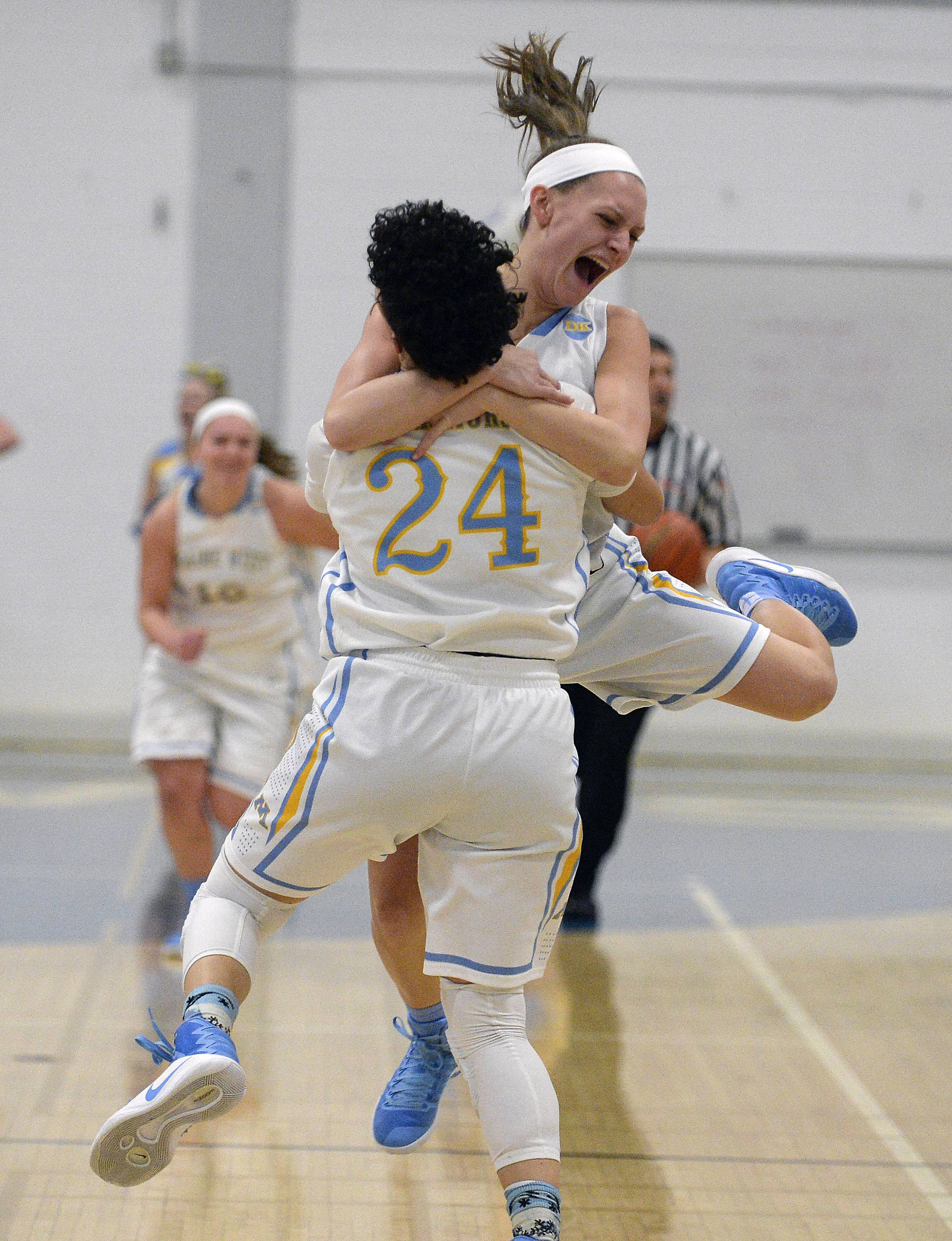 Maine West's Alisa Fallon and Catherine Johnson celebrate their Class 4A regional final win over New Trier at Maine West on Thursday.