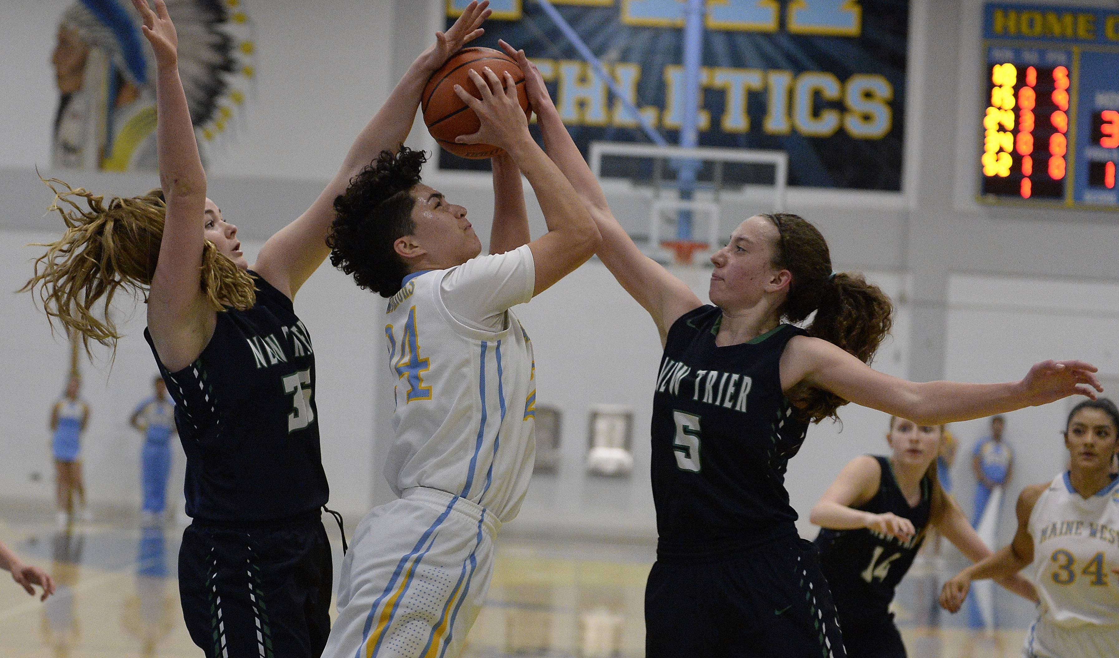 Maine West's Alisa Fallon goes up against Taite Ryan and Cate Murdock on a drive in the Warriors' regional final win over New Trier at Maine West on Thursday.