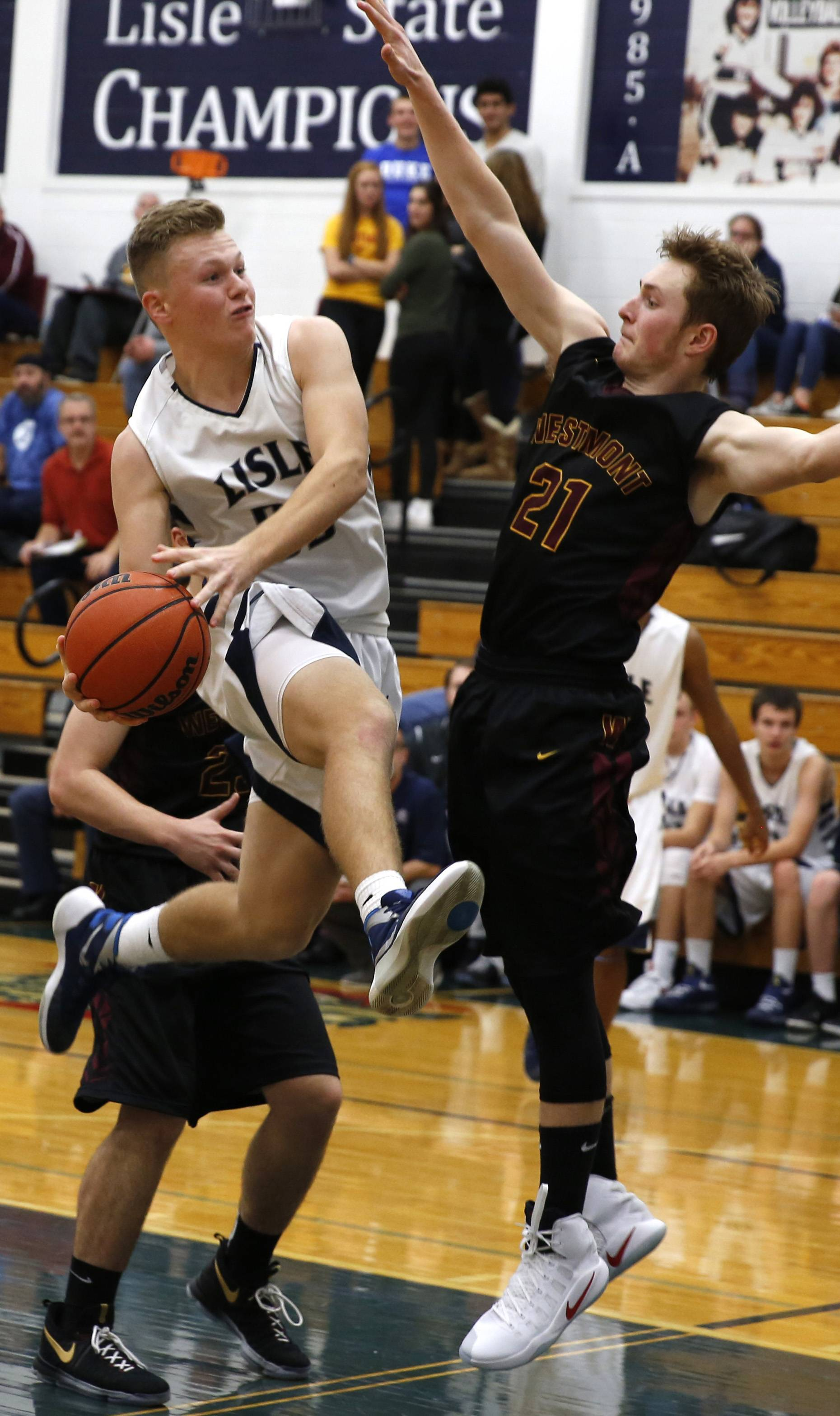 Lisle's Mark McGrath drives to the basket against Westmont's Michael Thompson (21) during the Lisle High School Thanksgiving Tournament.